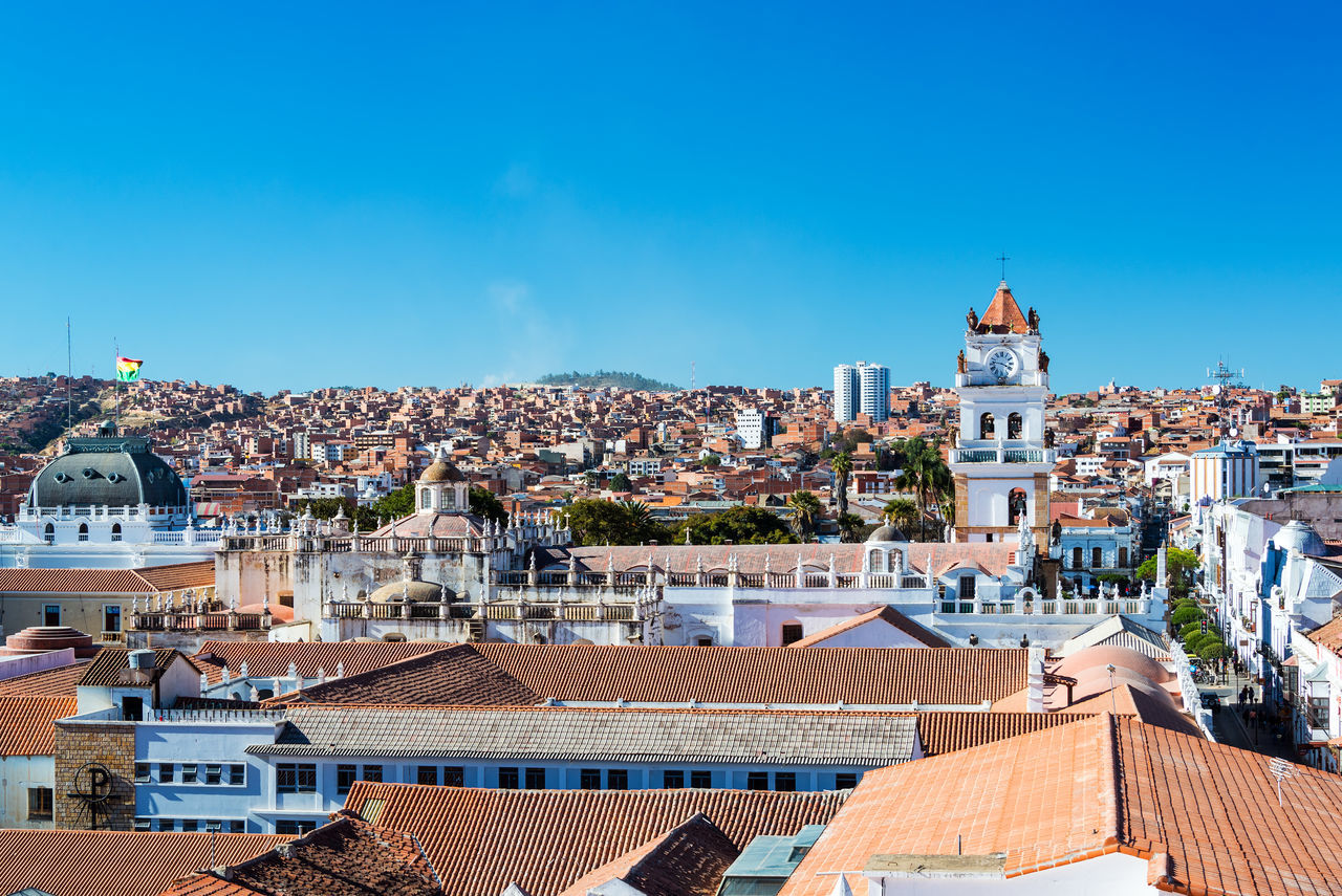 Cityscape of Sucre, Bolivia with the tower of the cathedral visible Architecture Architecture Blue Bolivia Building Exterior Built Structure Cathedral Church City Cityscape Colonial Colonial Architecture Day Dome No People Outdoors Place Of Worship Religion Roof Sky Sucre Tourism Travel Travel Destinations White