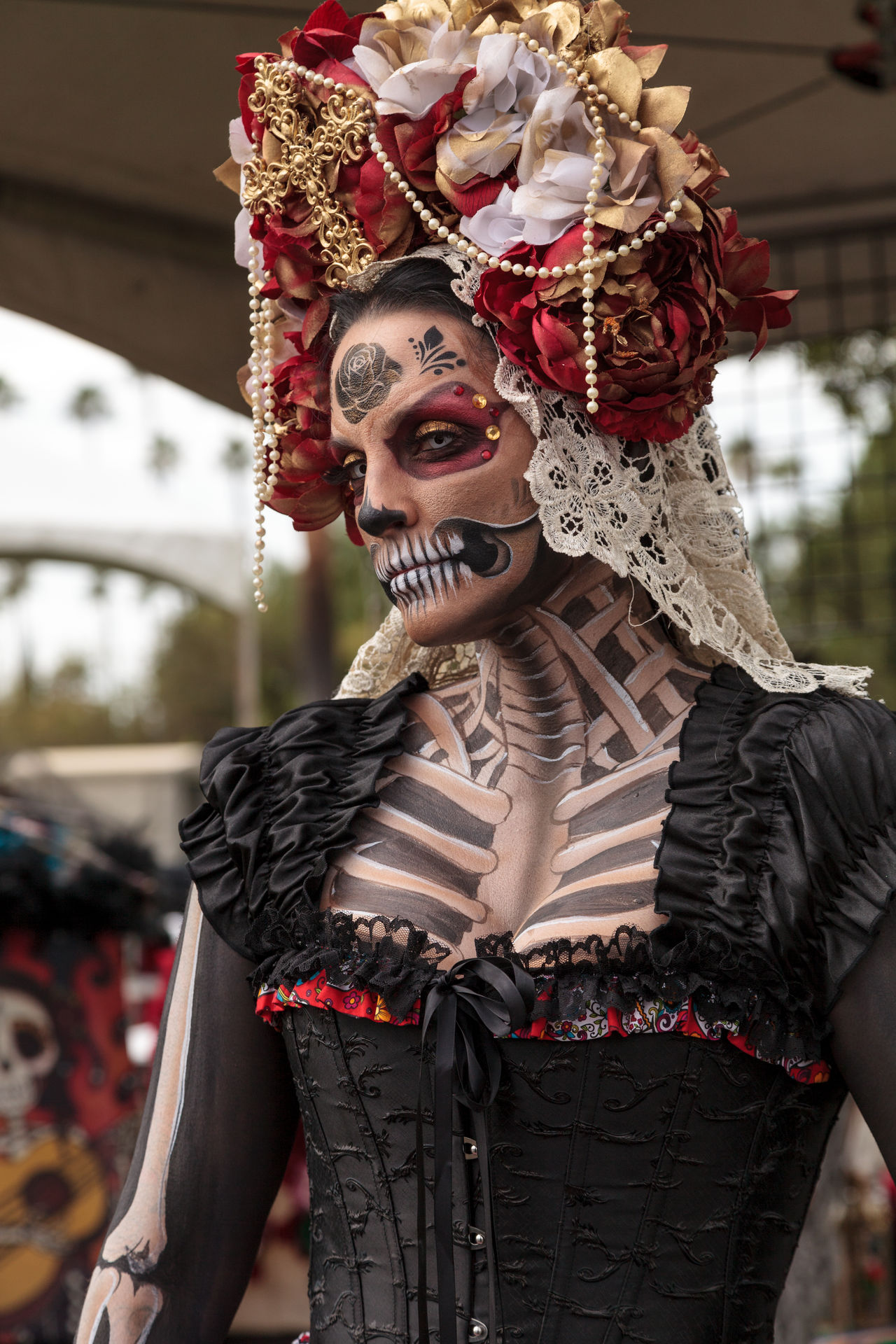 Los Angeles, CA, USA - October 29, 2016: Skeleton woman performer at Dia de los Muertos, Day of the dead, in Los Angeles at the Hollywood Forever Cemetery grounds. Editorial use only. Adult Adults Only Beauty Carnival Crowds And Details Cultures Day Headdress Human Body Part Men One Person Only Men Outdoors People Performance Portrait Skeleton Stage Make-up Woman Women Young Adult
