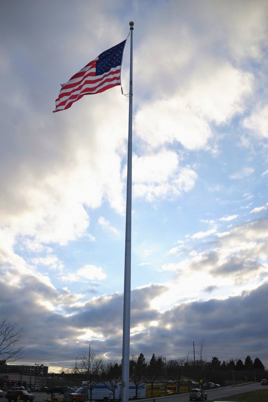 flag, patriotism, cloud - sky, sky, striped, low angle view, flag pole, no people, stars and stripes, outdoors, day, nature