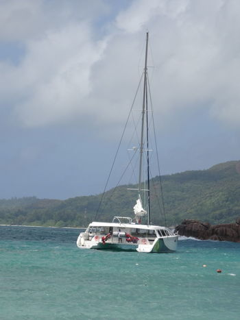 Nautical Vessel Water Sailboat Landscape Sea Nature Vacations Tranquility Beach Transportation Travel Destinations Adventure Seychelles Islands Seychelles Boat Ride Beauty In Nature Vacations Tropical Climate