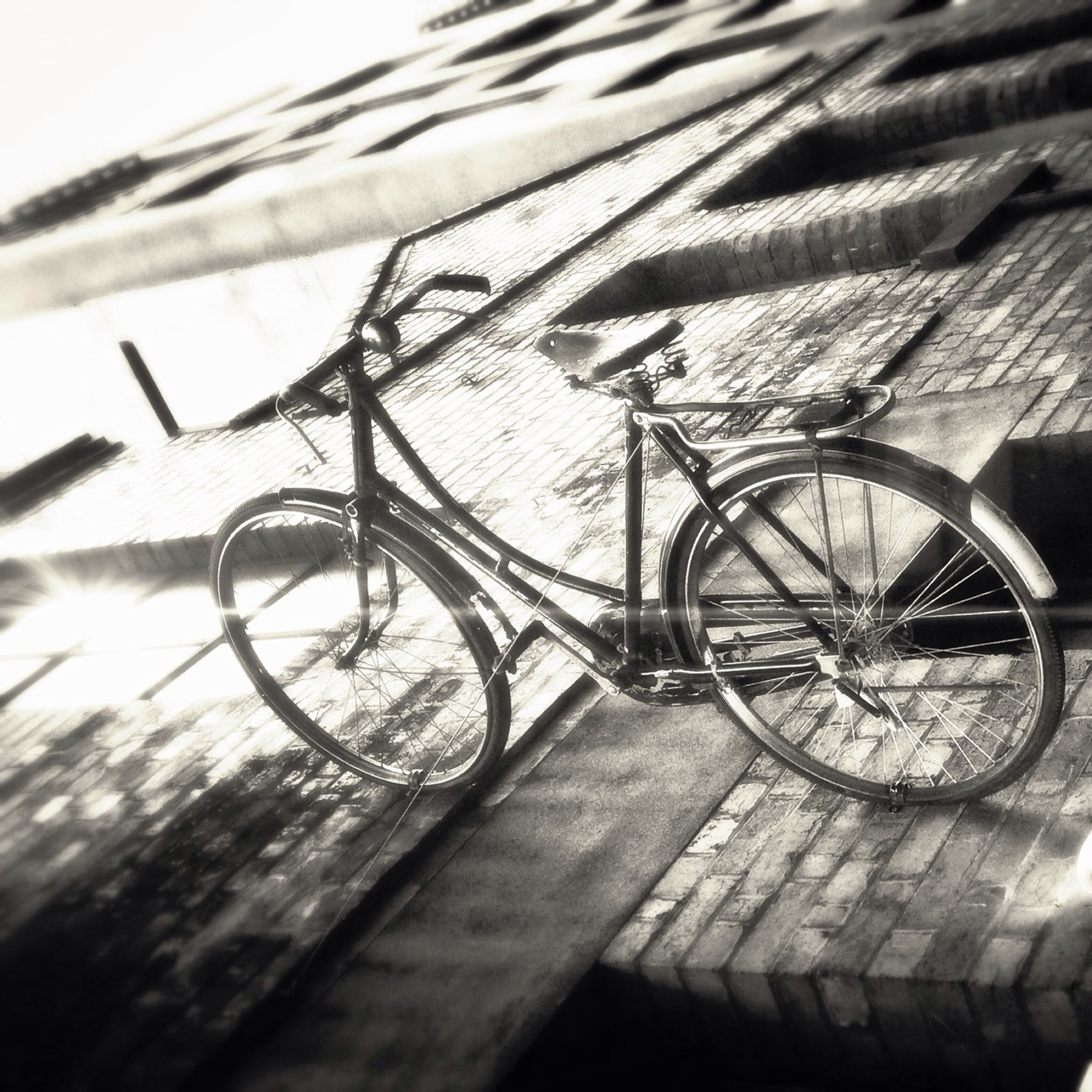 bicycle, wood - material, wheel, metal, close-up, built structure, wooden, wall - building feature, day, sunlight, outdoors, transportation, railing, no people, shadow, architecture, focus on foreground, selective focus, stationary, part of