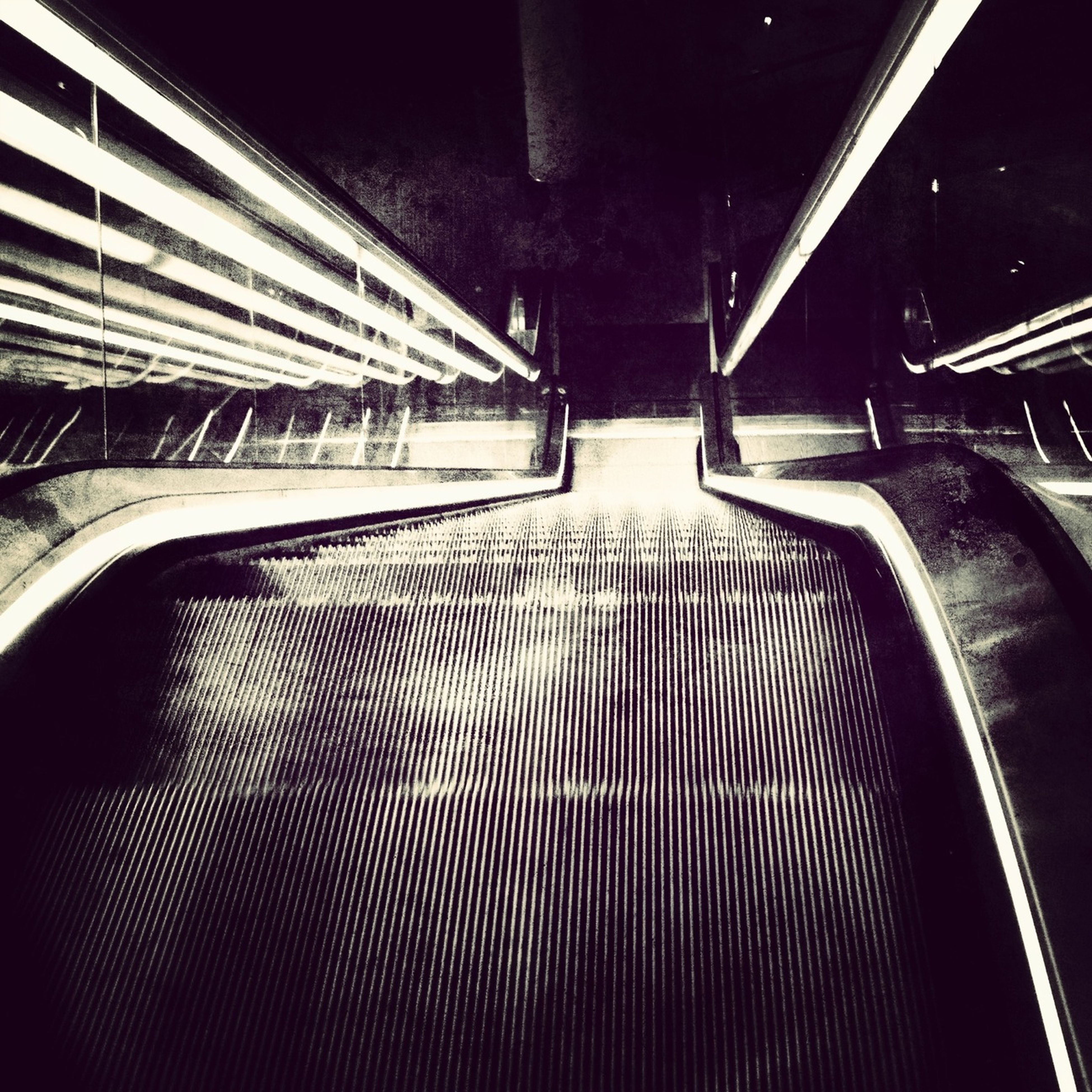 steps and staircases, steps, railing, staircase, indoors, high angle view, illuminated, escalator, empty, night, metal, absence, the way forward, built structure, transportation, pattern, architecture, no people, diminishing perspective, seat