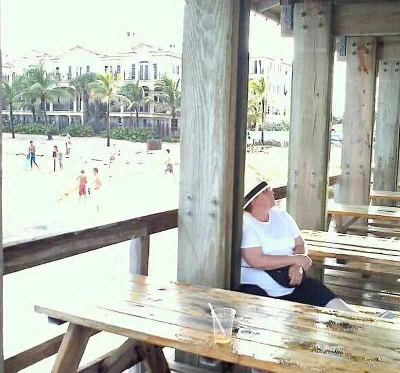 Alone Woman Pier Lostinthought she sits and waits for no one