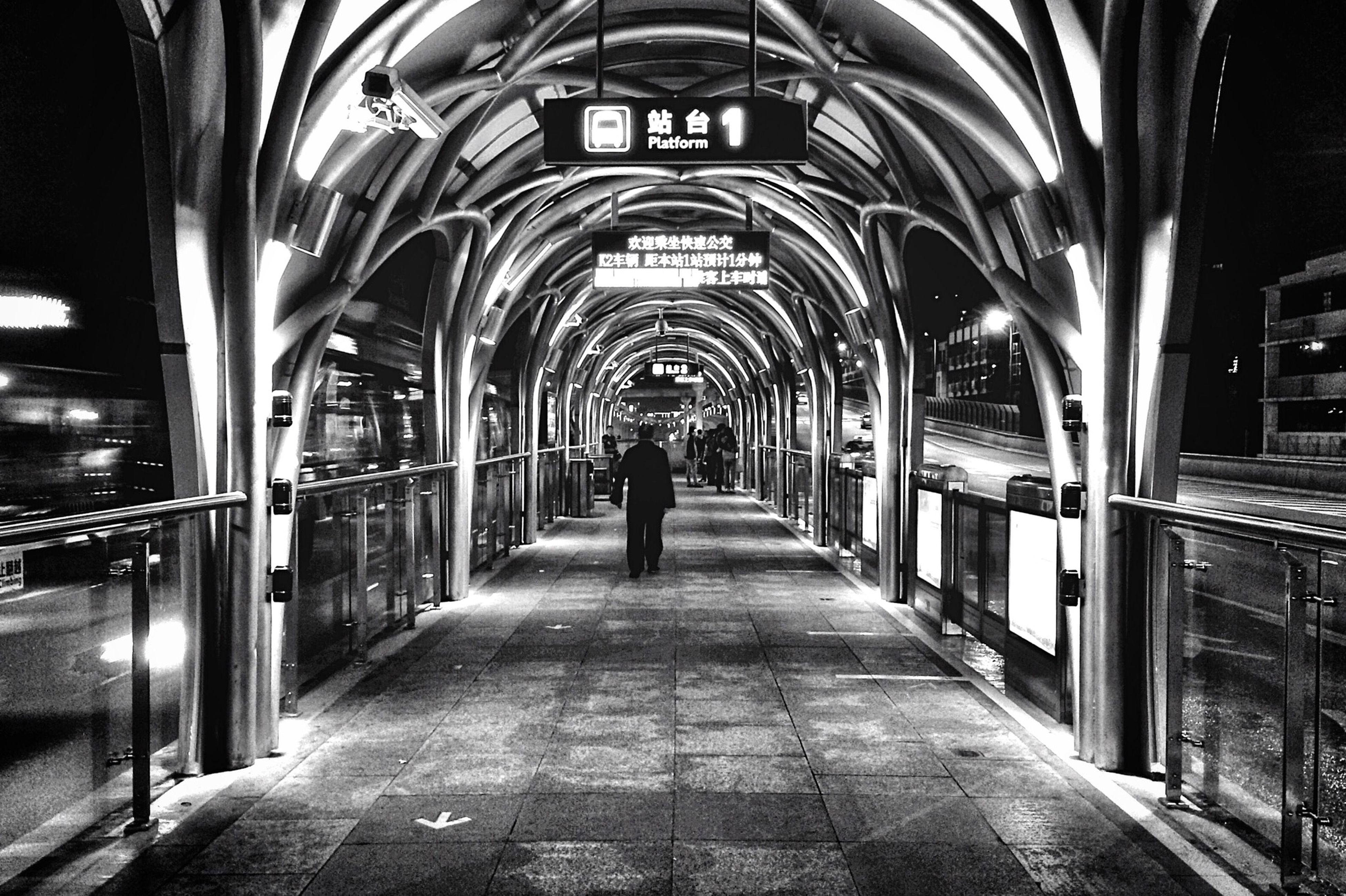arch, architecture, built structure, the way forward, indoors, walking, men, rear view, lifestyles, full length, illuminated, diminishing perspective, tunnel, transportation, incidental people, building exterior, archway, city