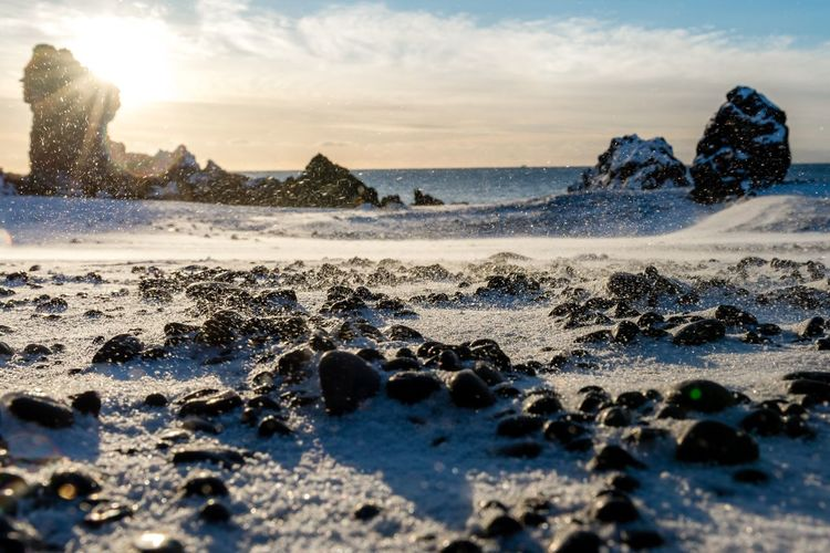 Snæfellsnes in Iceland An Eye For Travel Shades Of Winter Betterlandscapes Iceland Winter Landscape Black Stones Windy Day Snow And Ice  Snow Nature Sky Sea Beauty In Nature Water No People Outdoors Sunset Scenics Tranquility Cloud - Sky Beach Day Shades Of Winter