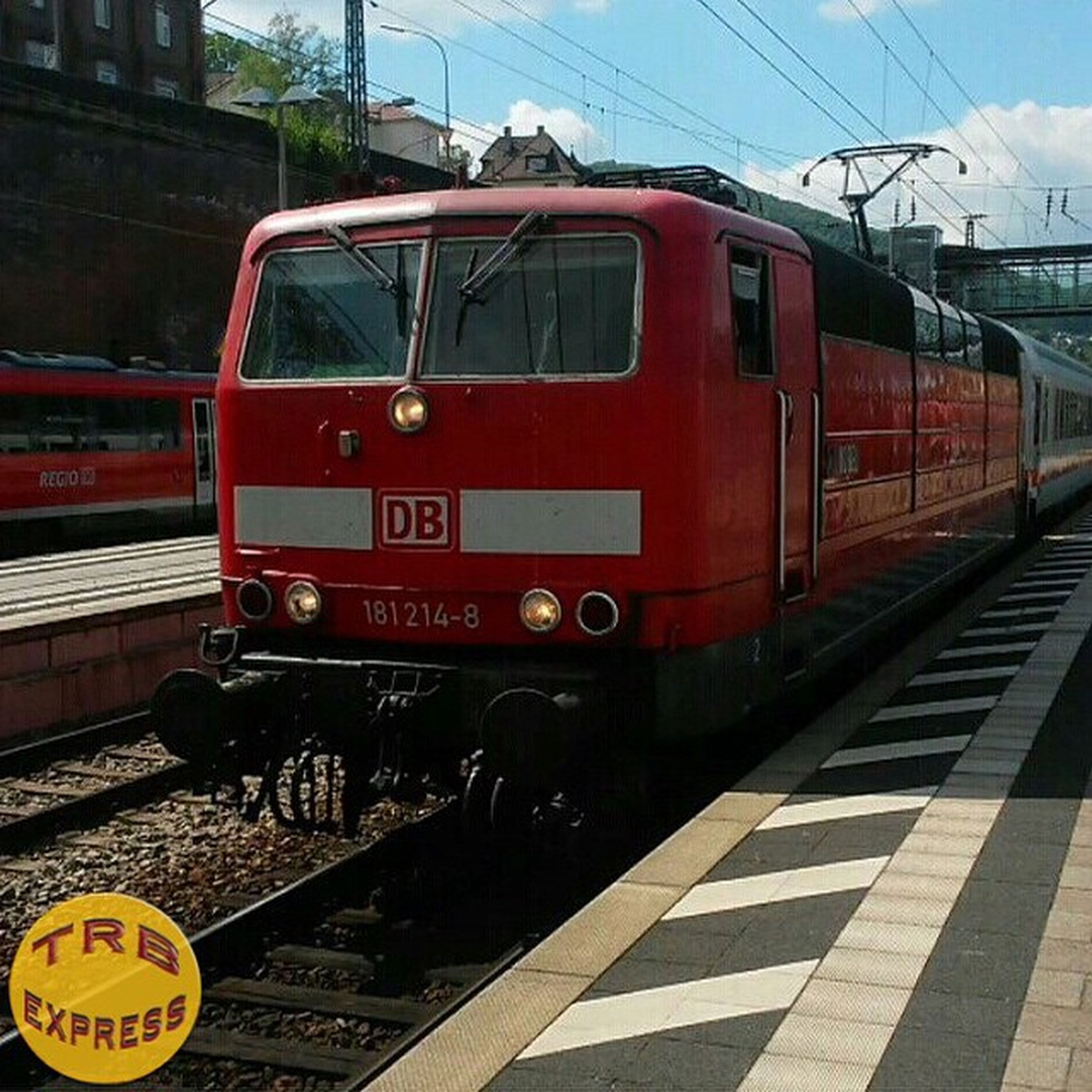 railroad track, transportation, rail transportation, public transportation, railroad station, train - vehicle, mode of transport, railroad station platform, passenger train, train, travel, public transport, text, communication, land vehicle, journey, power line, red, cable car, railway station