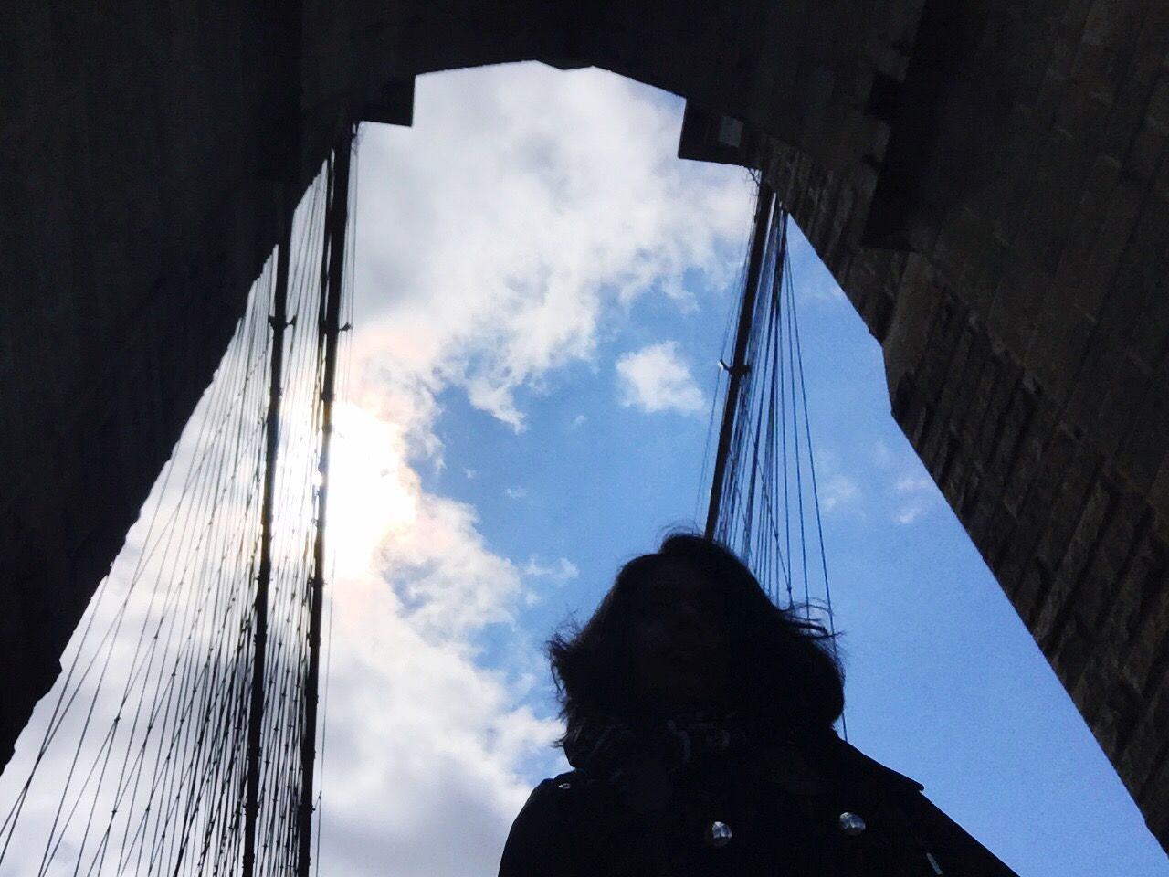 real people, one person, sky, low angle view, cloud - sky, day, outdoors, women, built structure, architecture, people