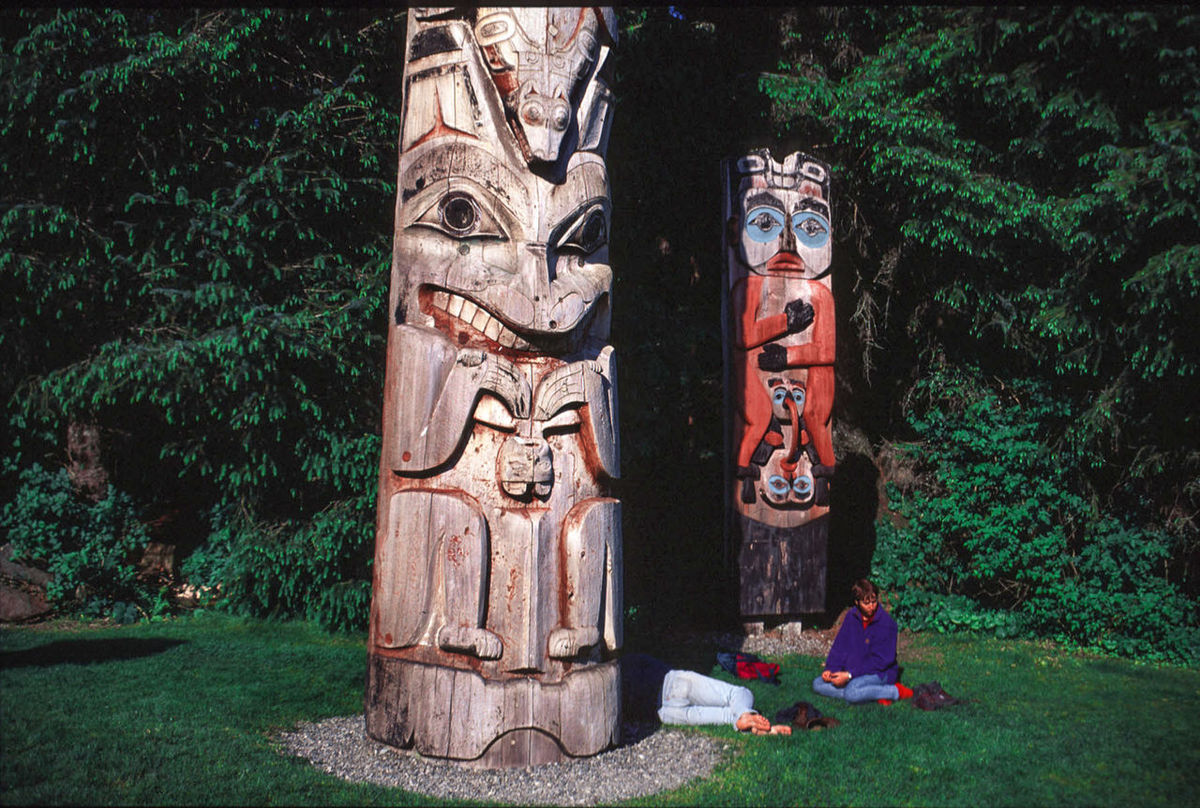 Sitka Alaska Totems Alaska Art Carved Wood Day Grass Green Color Growth Multi Colored Nature Outdoors Park People Plant Sitka Texas Tree Tree Trunk Two