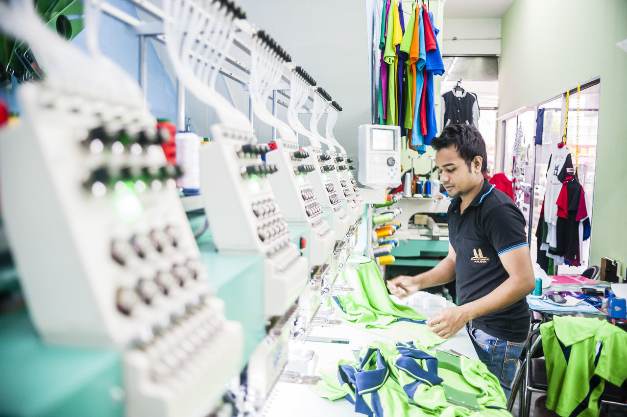 Business Embroidery Focus On Foreground Industrial Industry Machinery Machines Male Man Multi Colored Objects Occupation People Printing Selective Focus Sewing Machine Still Life Textile Threads Worker Working