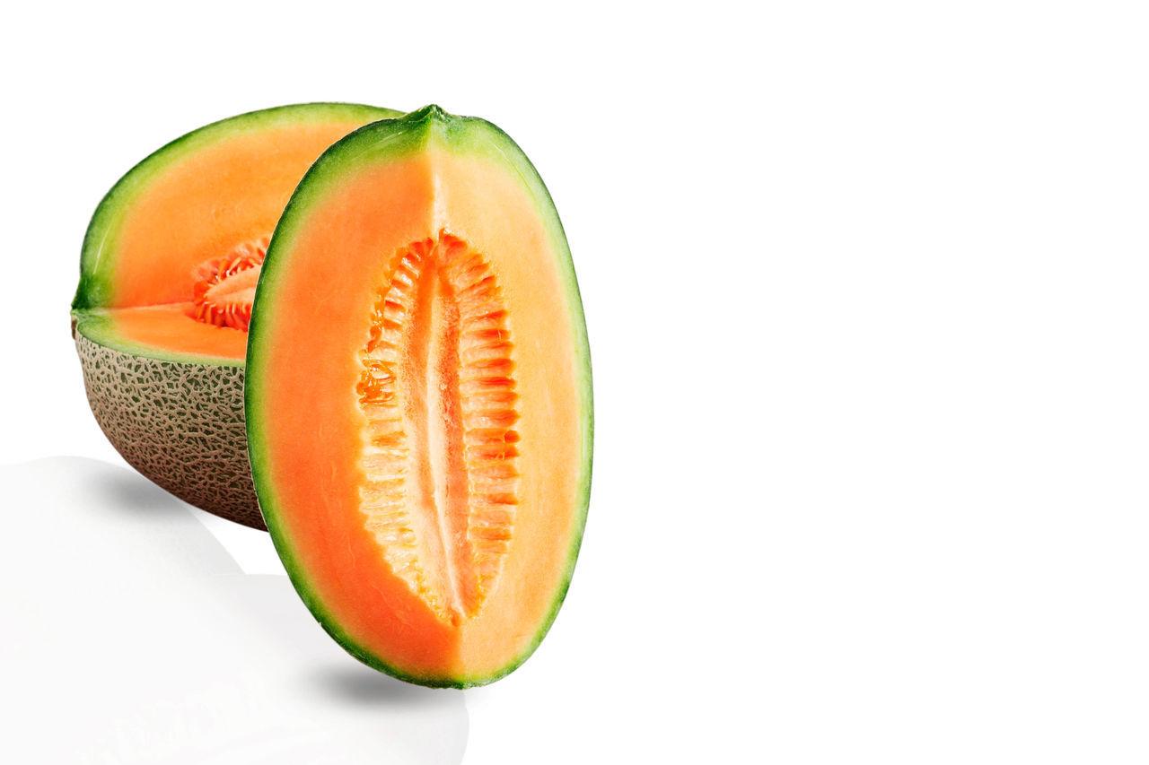 Close-Up Of Cantaloupe Against White Background
