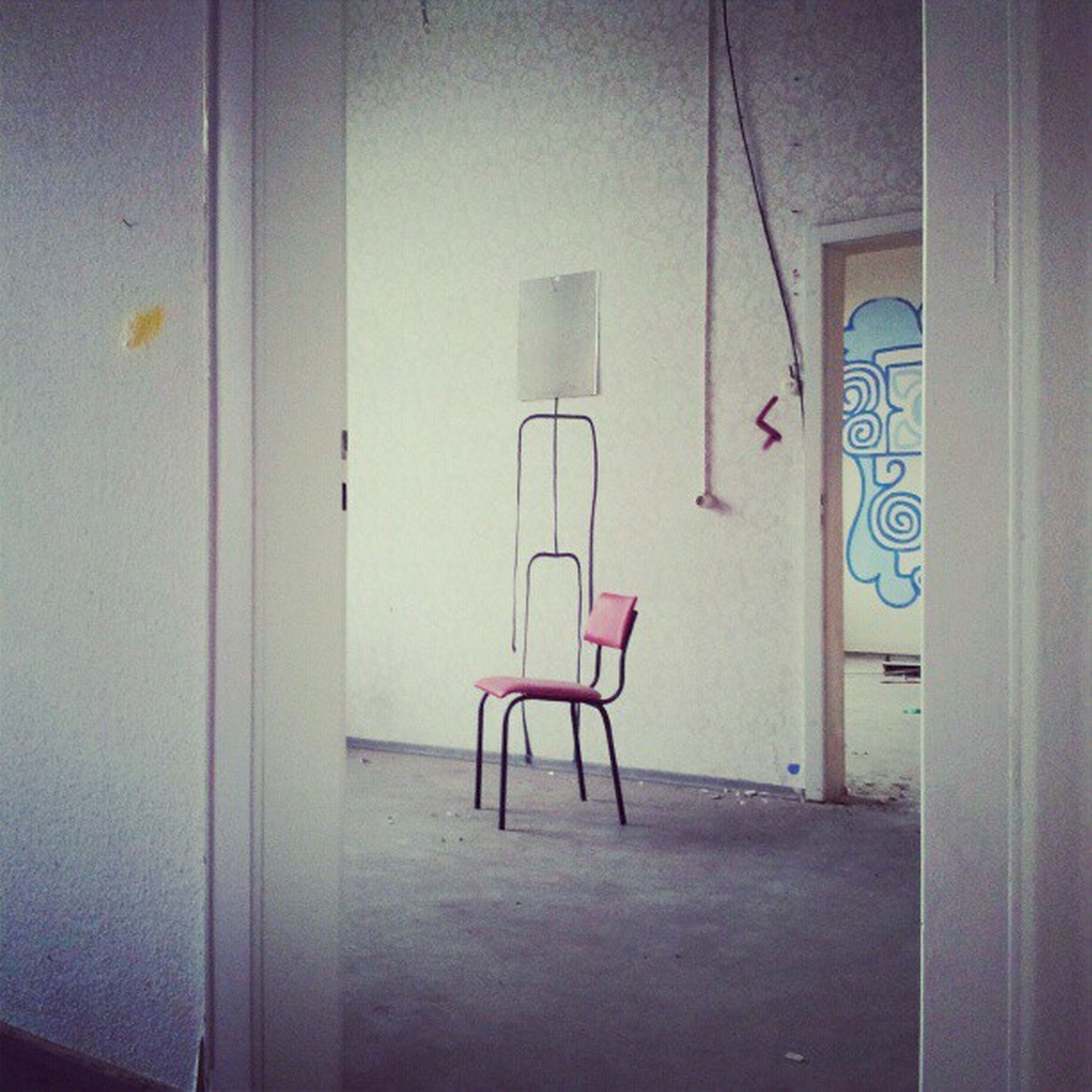 indoors, door, wall - building feature, communication, architecture, built structure, text, wall, empty, closed, no people, absence, western script, house, red, day, window, chair, metal, home interior