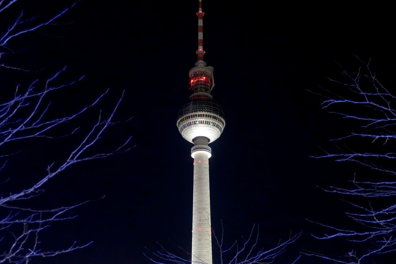 View of the Berlin TV Tower at night. Berlin Black Broadcasting Centered City Communication Dark Fernsehturm Global Communications Illuminated Landmark Low Angle View Night Nightphotography No People Outdoors Sky Sphere Tall - High Tourism Tower Travel Travel Destinations TV Tower Twigs