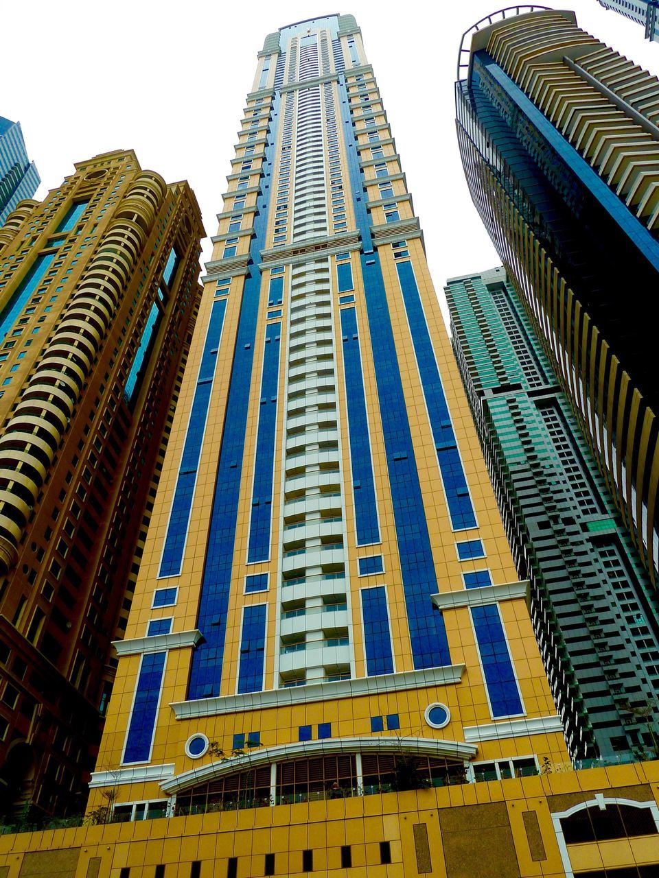 architecture, low angle view, building exterior, built structure, skyscraper, modern, outdoors, day, no people, city, clear sky, sky
