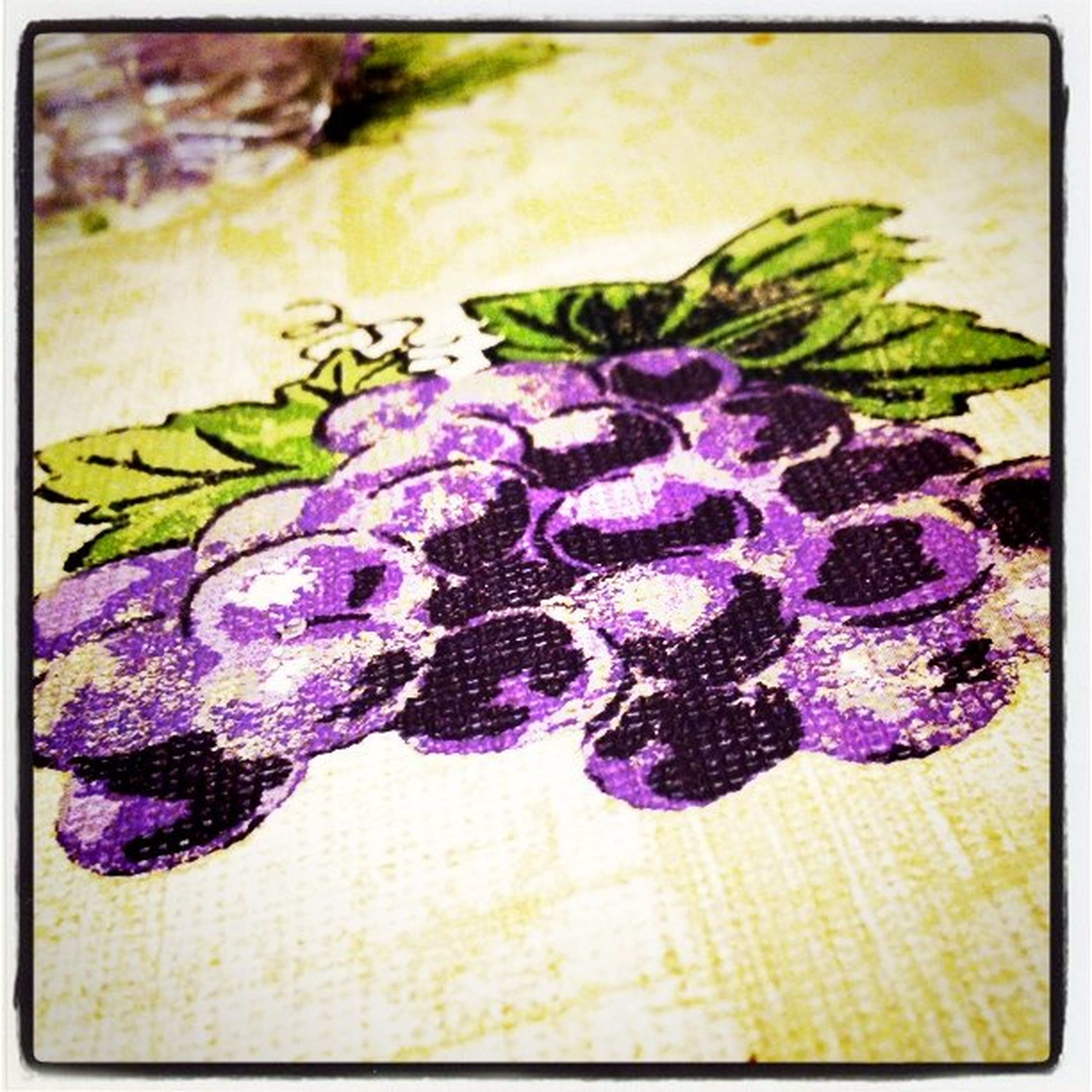 transfer print, auto post production filter, purple, flower, close-up, indoors, fragility, insect, high angle view, plant, no people, still life, art and craft, freshness, nature, creativity, animal representation, table, petal, selective focus