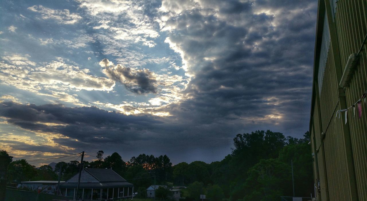 cloud - sky, sky, built structure, building exterior, architecture, no people, nature, tree, house, storm cloud, sunset, scenics, beauty in nature, outdoors, day, thunderstorm, city