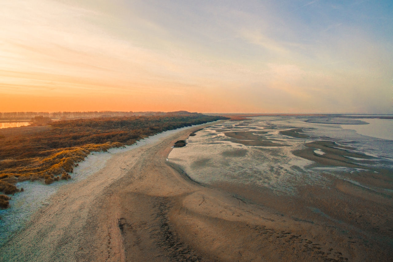 Sand Beach Nature Sky Outdoors Sunset Tranquility Beauty In Nature Landscape Sand Dune Scenics Day No People Nature Dutch Skies Drone  Dronephotography Dutch Landscape Horizon Holland Parallel Droneshot Sunlight Cloud - Sky Sea
