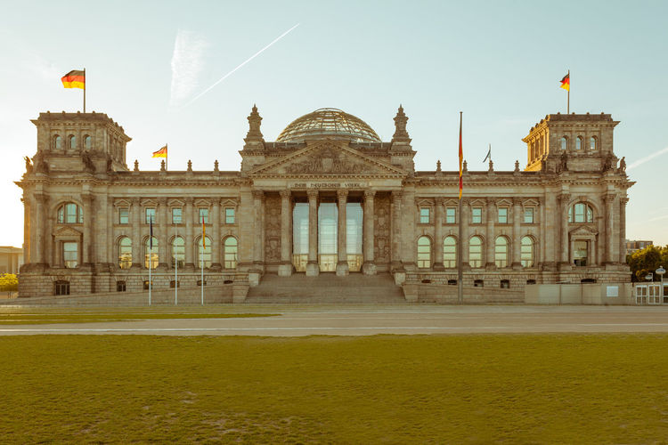 Berlin Bundestag Government Politics Architecture Building Exterior Built Structure Capital Day Europe Flag Germany Government History Landmark No People Outdoors Parliament Patriotism Reichstag Sky Travel Destinations
