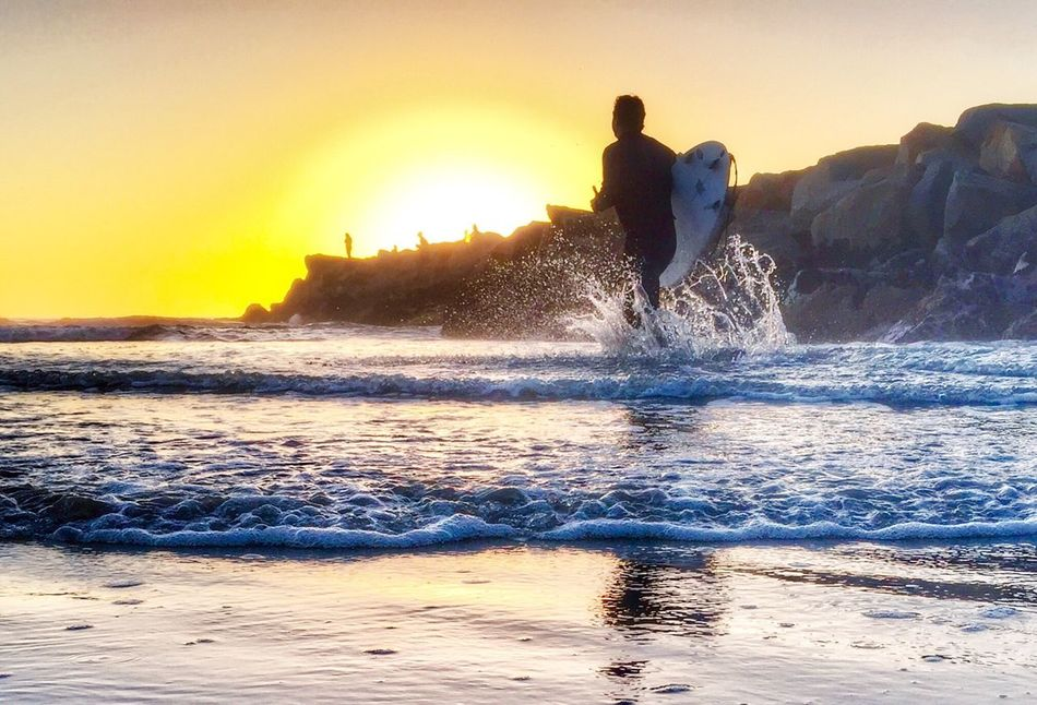 Surfing Sunset Sea Wave Real People Water Leisure Activity Beach Nature Beauty In Nature Men Lifestyles Splashing One Person Surfing Silhouette Sand Motion Outdoors Vacations Sky Oceanside Storiesbydebbie
