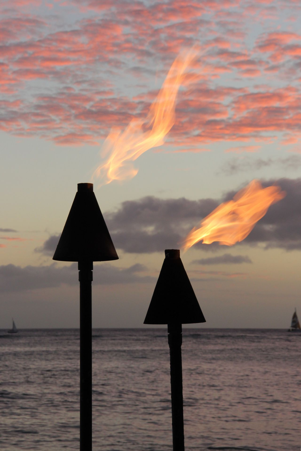 Sunset Water Tranquil Scene Guidance Tranquility Scenics Sea Communication Fire Torch Torchlight Flare Flares Seascape Information Sign In A Row Beauty In Nature Outdoors Nature Cloud - Sky Dramatic Sky Blue Ocean Non-urban Scene