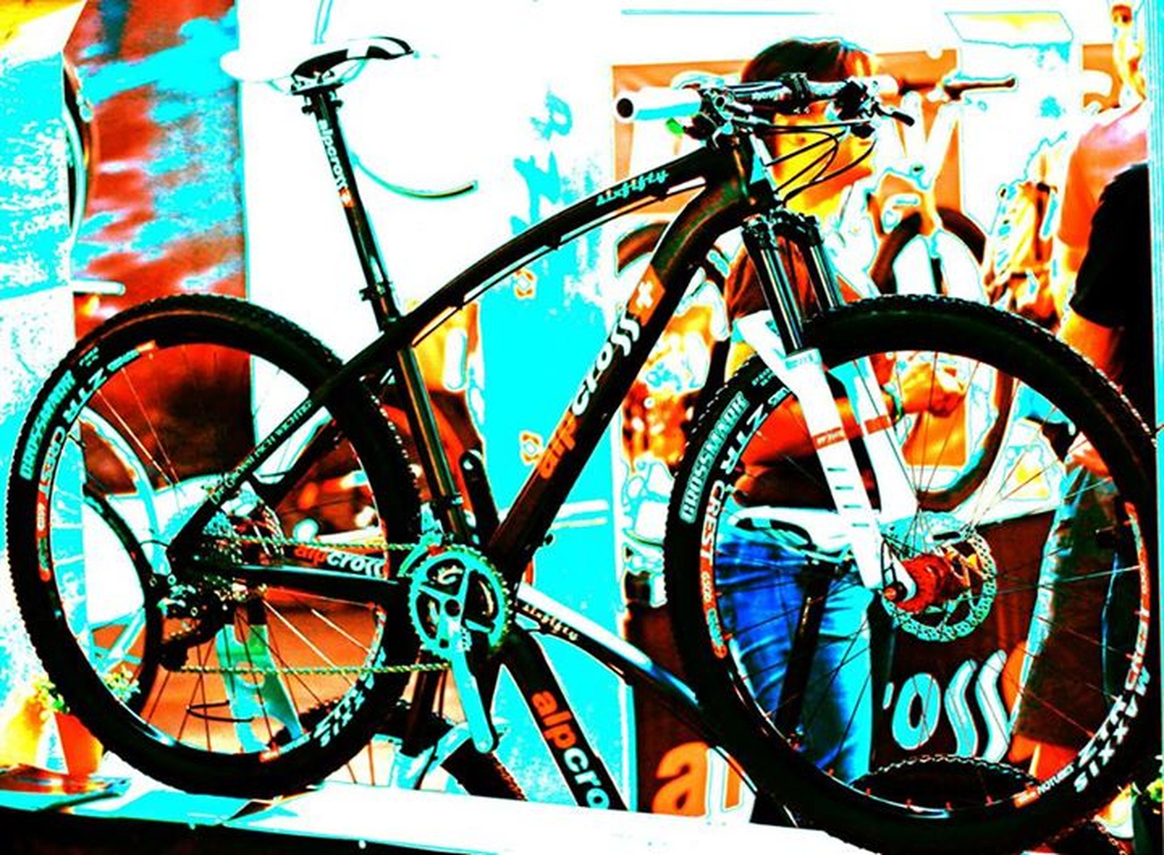 bicycle, multi colored, wall - building feature, graffiti, art and craft, creativity, blue, art, stationary, day, no people, wall, transportation, outdoors, wheel, mode of transport, parking, close-up, built structure, yellow