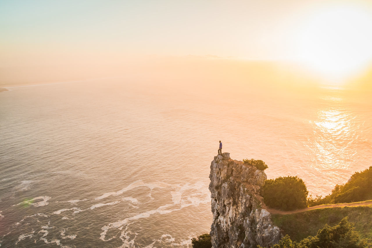 Beauty In Nature Cliff Day Destination Holiday Mountain Nature Nature Nazare Portugal Nazaré  Ocean View On The Edge Orange Outdoors Rock Scenics Sky And Clouds Standing Sunset Tranquility Travel Destinations Trip Vacation View Water