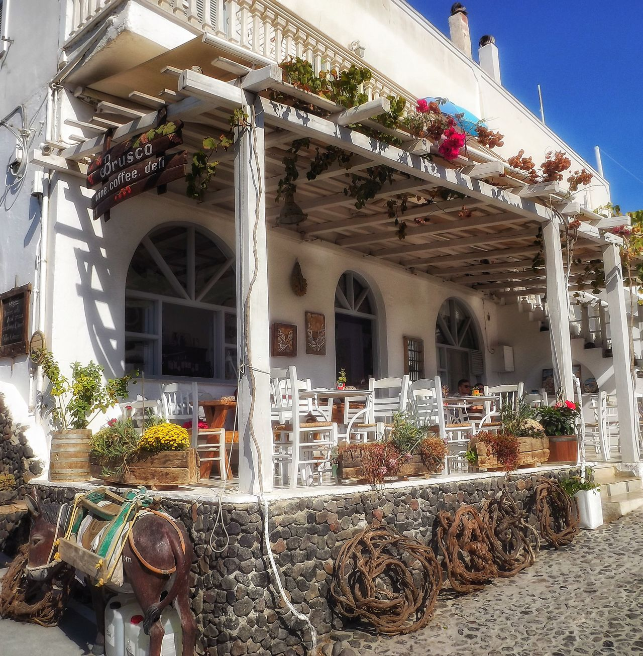 Traditional Greek coffee shop Architecture Outdoors No People Greek Beauty Tourism Landscape_photography EyeEm Masterclass Travel Destinations Santorini, Greece Malephotographerofthemonth Hdr_captures Fujifilm Creative Light And Shadow Color Photography Architecture Coffee Shop Coffeehouse Greek Coffee  Santorinigreece Portrait_shots