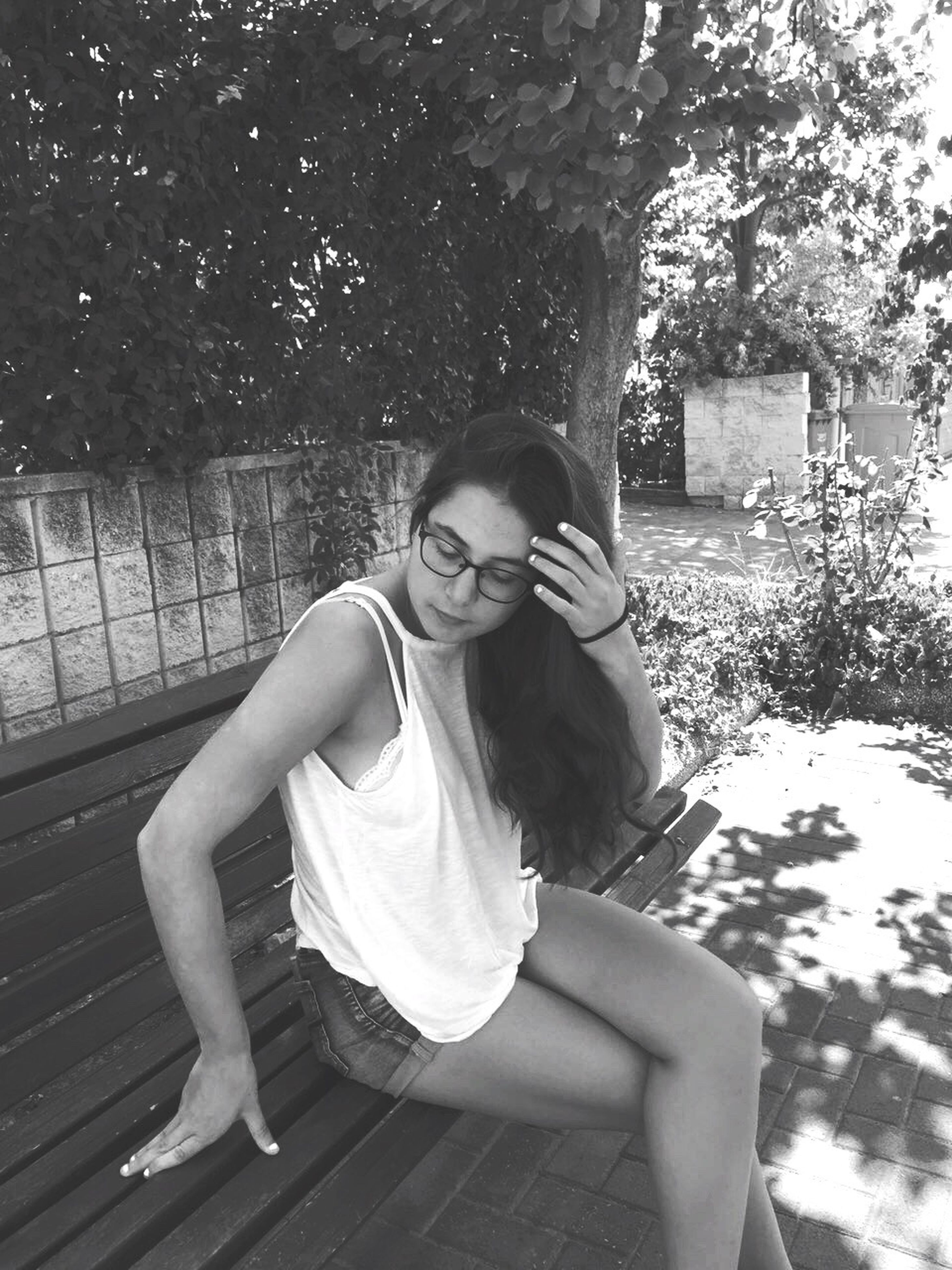 eyeglasses, young adult, portrait, tree, sitting, one woman only, one person, young women, outdoors, people, adults only, day, adult