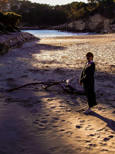 Menorca Cala Check This Out Enjoying Life EyeEm Gallery Check This Out Woman Portrait Contraluz Contrast Silhouettes Of People Evening Light Beach Beachphotography Dead Tree Light And Shadow Sand FootPrint Footprints In The Sand Learn & Shoot: Balancing Elements Eveningsun The 43 Golden Moments
