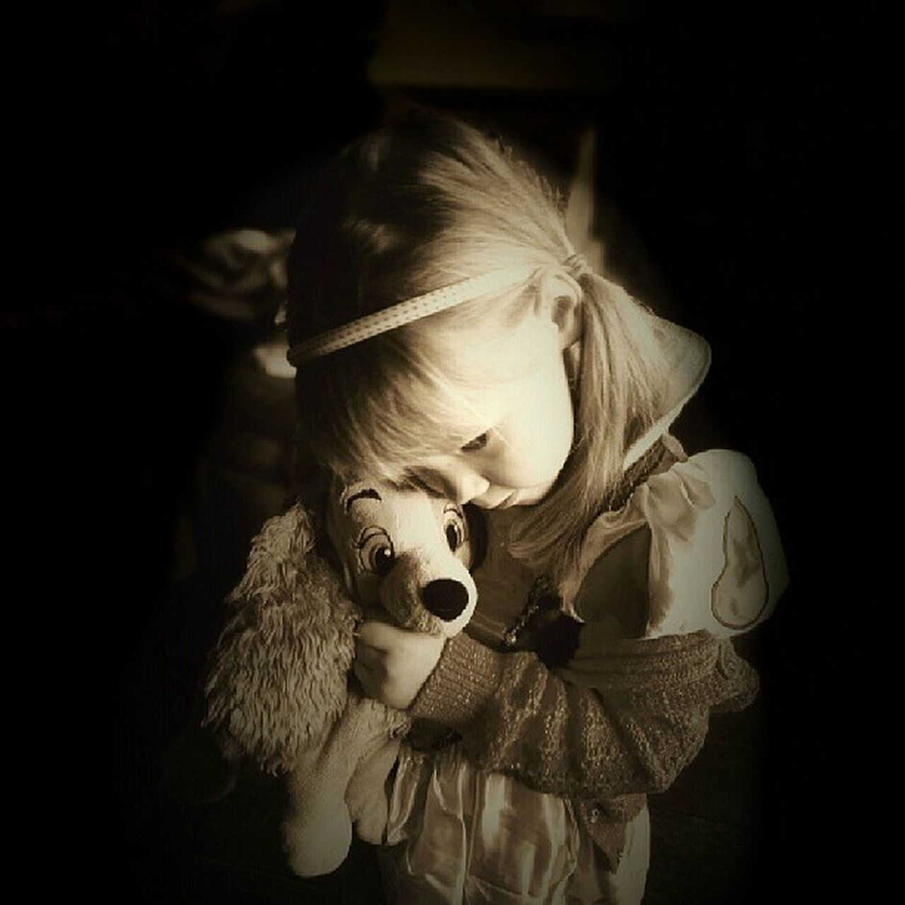 childhood, child, one girl only, girls, stuffed toy, one person, blond hair, children only, teddy bear, indoors, spooky, black background, people, close-up, halloween, day