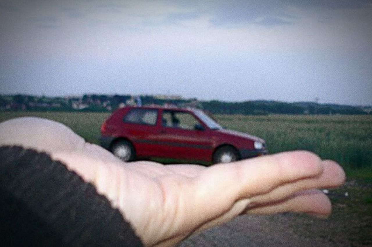 Holding or presenting a car Human Hand Human Body Part One Person People Adult Adults Only Holding Outdoors Nature Day Sky One Man Only Adventure Point Of View Landscape Close-up Young Adult Car Volkswagen Polo Red Illusion Optical Illusions Optische Täuschung