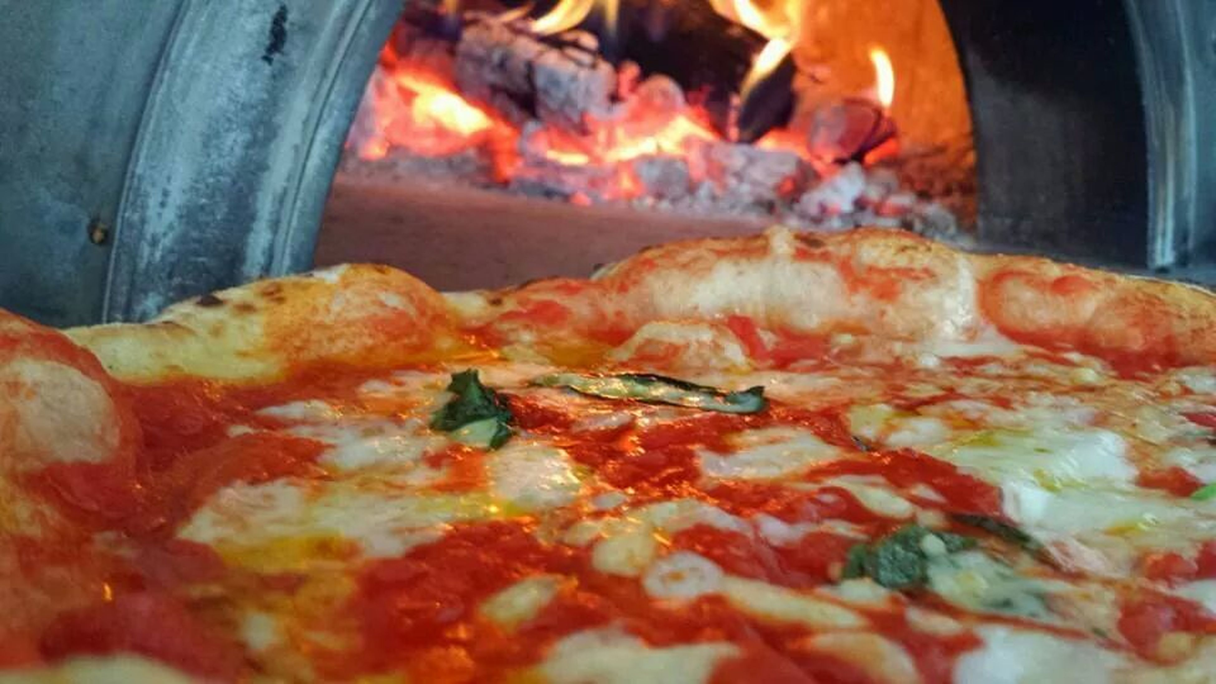 indoors, food and drink, food, close-up, orange color, flame, burning, heat - temperature, selective focus, still life, fire - natural phenomenon, pizza, no people, ready-to-eat, freshness, unhealthy eating, meat, preparation, focus on foreground