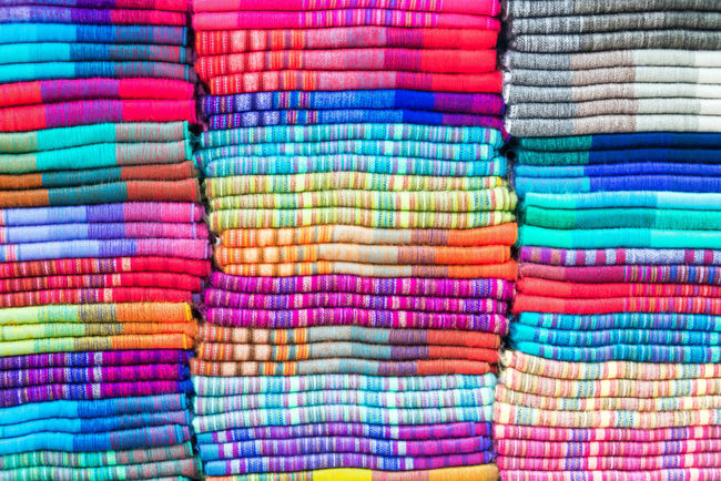 Soft colorful blankets made out of alpaca wool in the famed market of Otavalo, Ecuador Alpaca Background Blankets Bright Cloth Color Colorful Craft Design Ecuador Fabric Indian Indigenous  Llama Market Native Otavalo Otavalo, Ecuador Pattern South America Textile Thread Traditional Wool Woven
