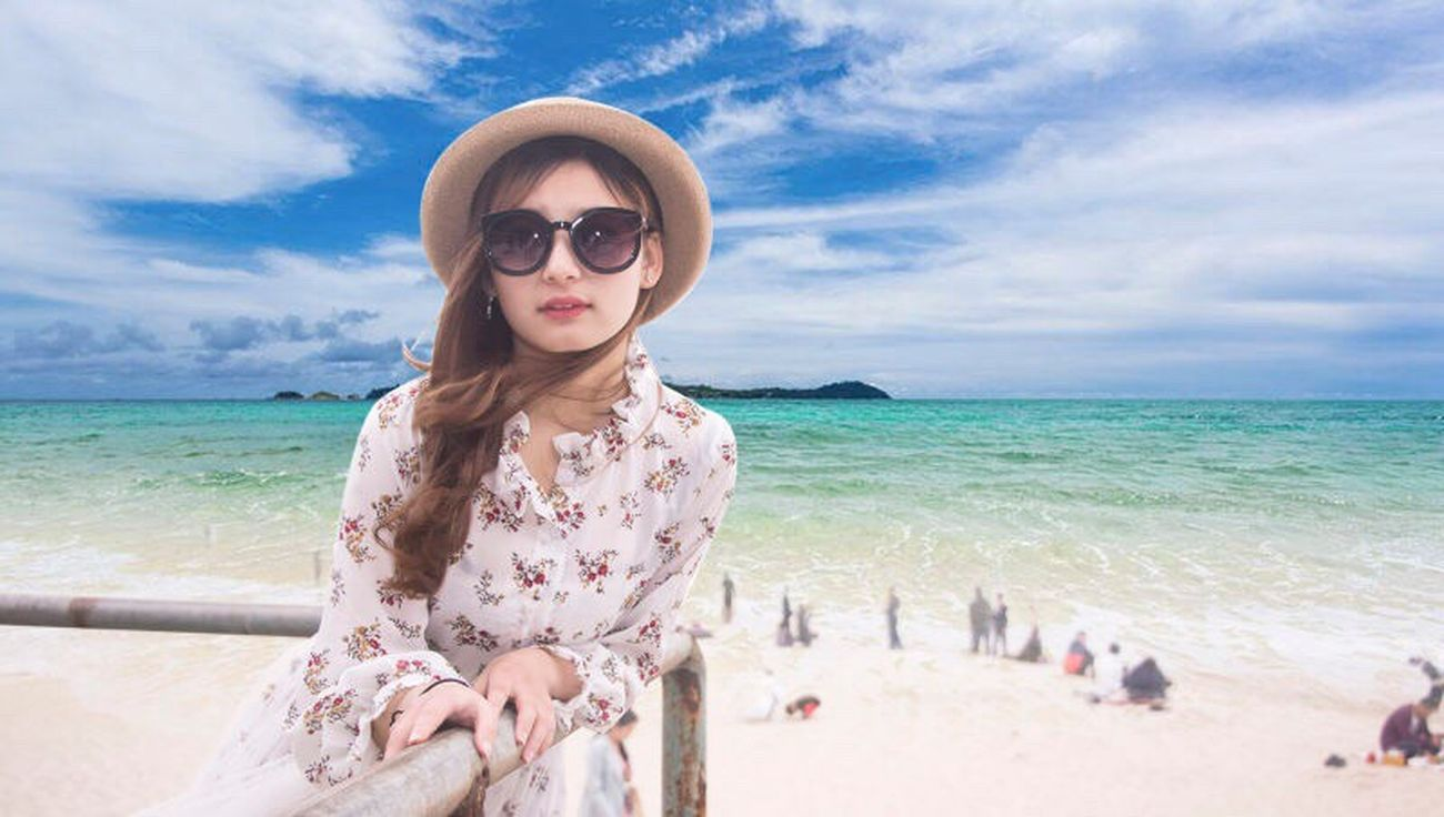 Sea Beach Vacations Beauty Horizon Over Water Travel Destinations Sand Looking At Camera Portrait Sunglasses Travel Only Women Beautiful People Cloud - Sky Outdoors One Woman Only Sky Adult Tourism People