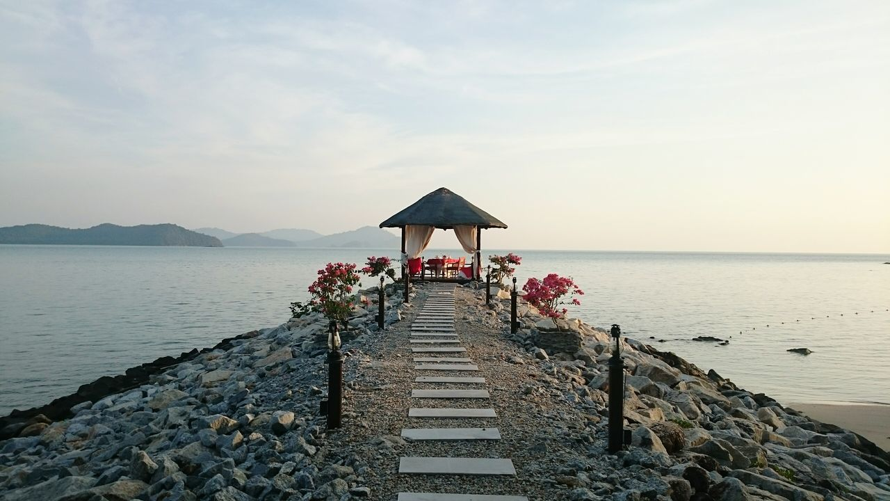Water Pier Tranquility Built Structure Tranquil Scene Nature Outdoors Jetty Seascape Scenics Huaweiphotography HuaweiP9plus EyeEm Best Shots Composition Photography Photooftheday Beach Waterfront Tourism Calm Sky Sea The Way Forward Personal Perspective EyeEm