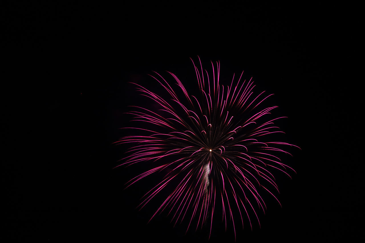 July 04 Fireworks Arts Culture And Entertainment Black Background Black Background Blurred Motion Celebration Event Exploding Firework Firework - Man Made Object Firework Display Fireworks Glowing Illuminated Long Exposure Low Angle View Night Night Sky No People Outdoors Room For Text Sky Spark