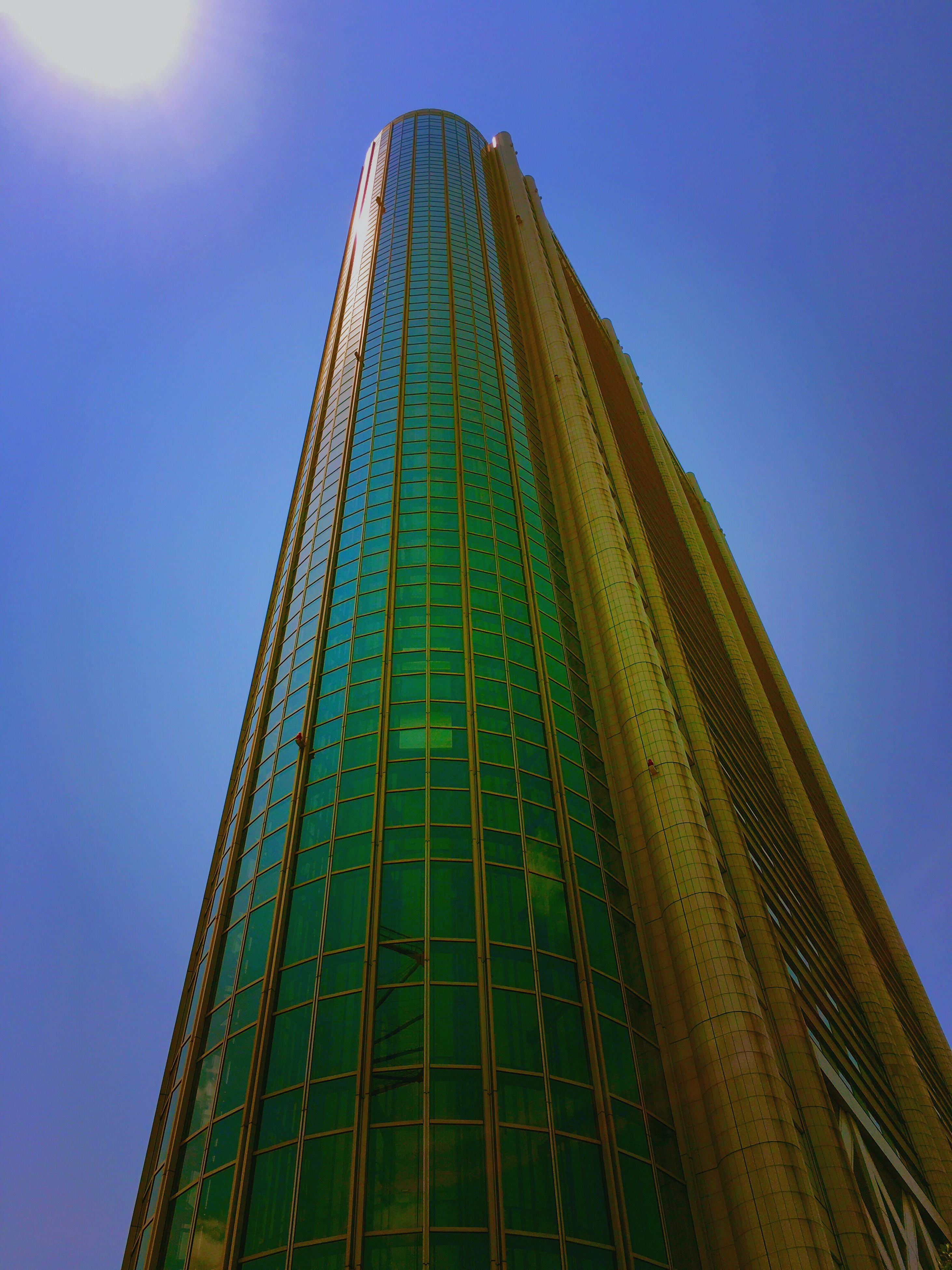 low angle view, built structure, architecture, blue, clear sky, tall - high, sunlight, tower, famous place, building exterior, sky, metal, travel destinations, outdoors, international landmark, day, no people, travel, copy space, tourism