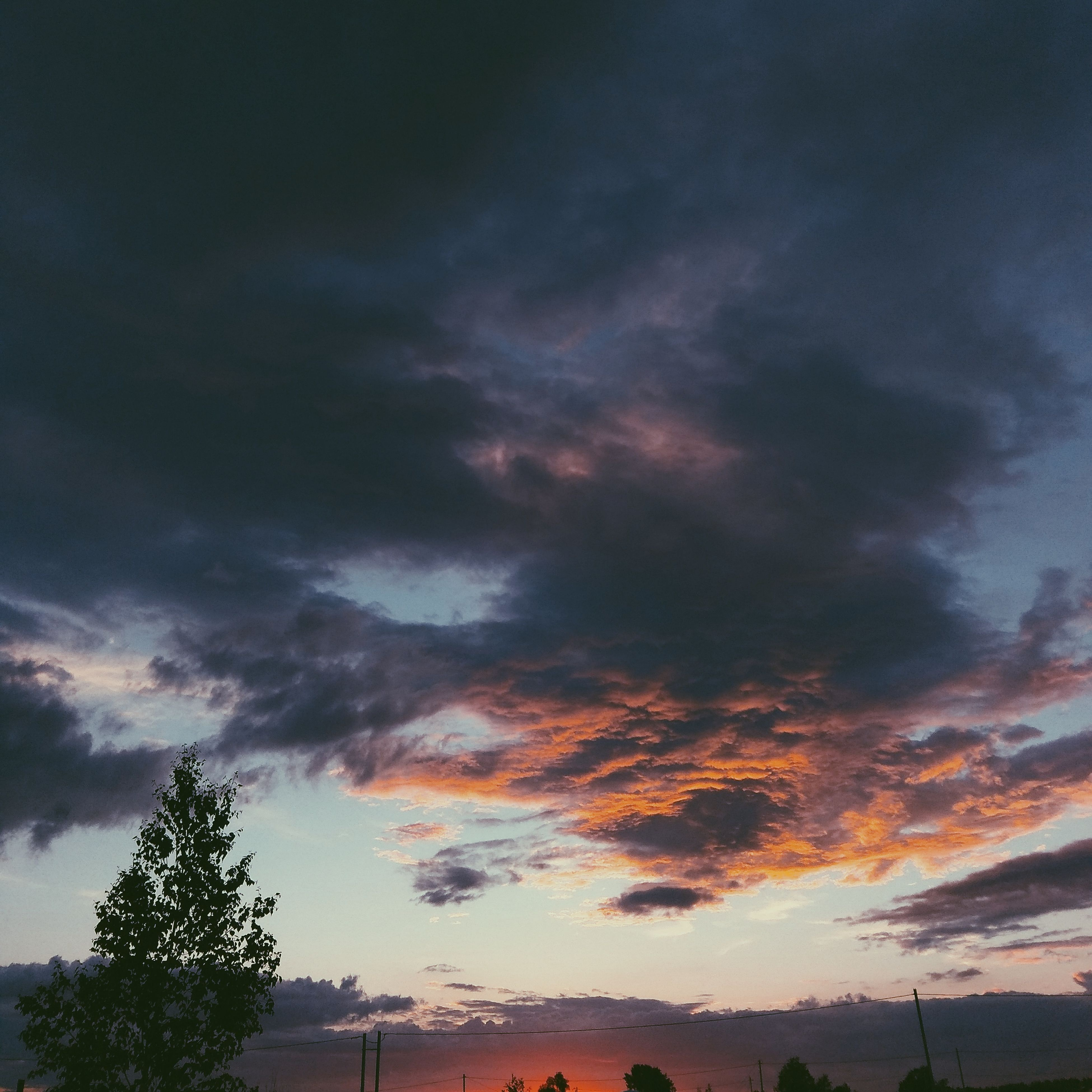 sunset, cloud - sky, dramatic sky, sky, beauty in nature, nature, tree, scenics, orange color, low angle view, no people, tranquil scene, tranquility, silhouette, weather, outdoors, storm cloud, day