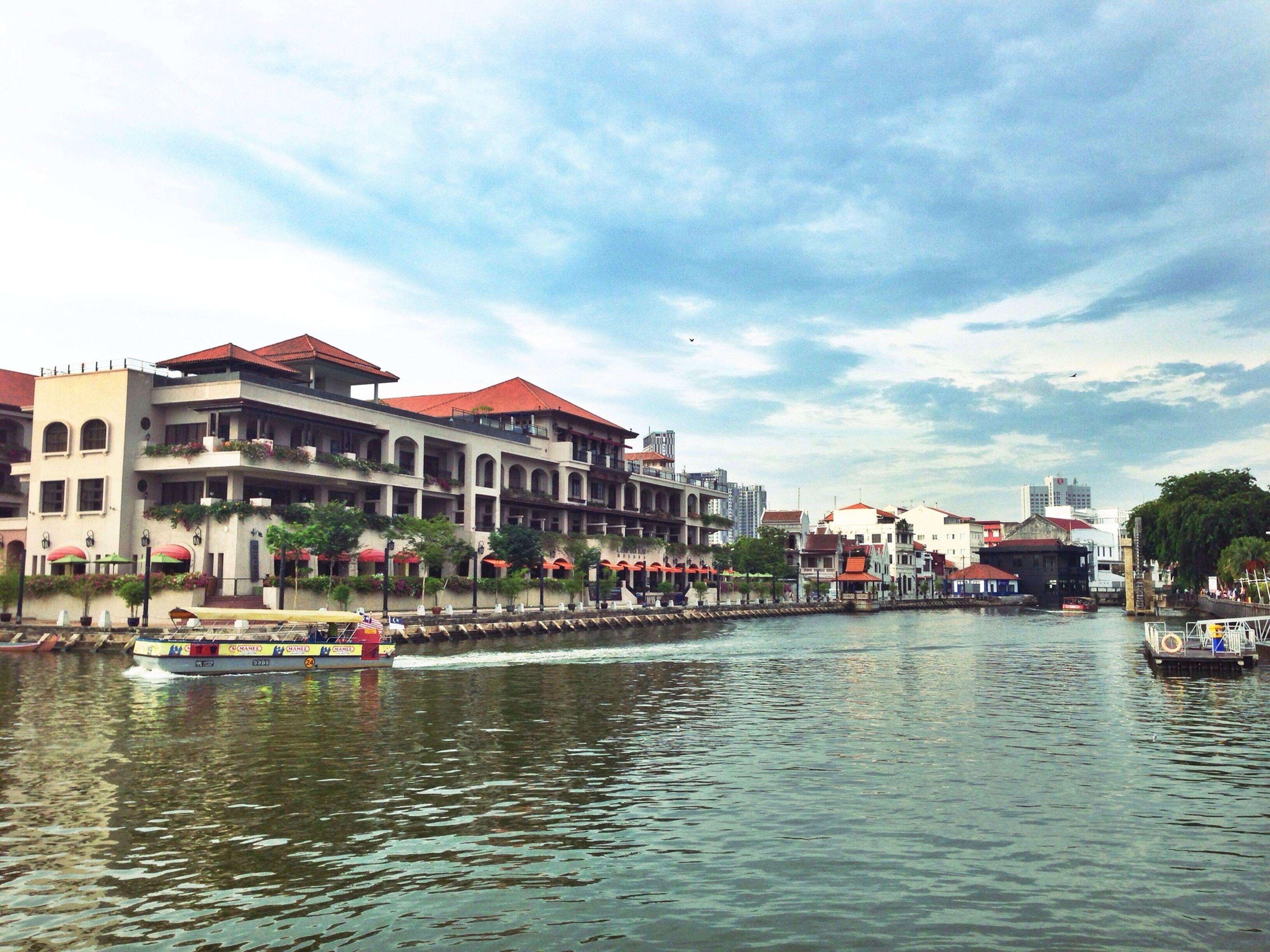 building exterior, architecture, built structure, water, sky, waterfront, nautical vessel, transportation, mode of transport, boat, cloud - sky, moored, residential structure, city, residential building, canal, house, cloud, river, incidental people
