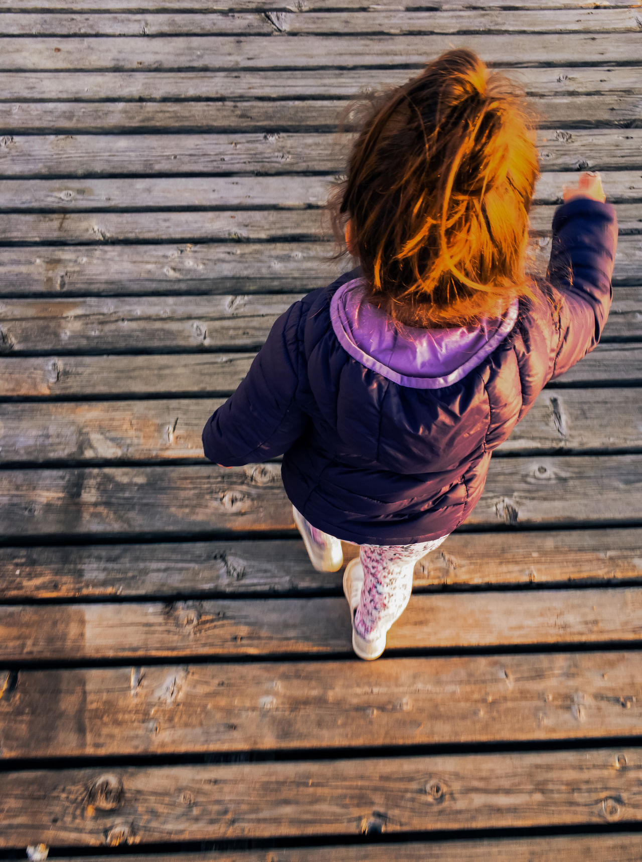 Small girl with orange hair on boardwalk top view Adorable Boardwalk Carefree Caucasian Child Childhood Cute Day Girl Hair Kid Leisure Activity Lifestyles Little Marine One Person Orange Outdoors People Pier Rear View Sea Small Wooden