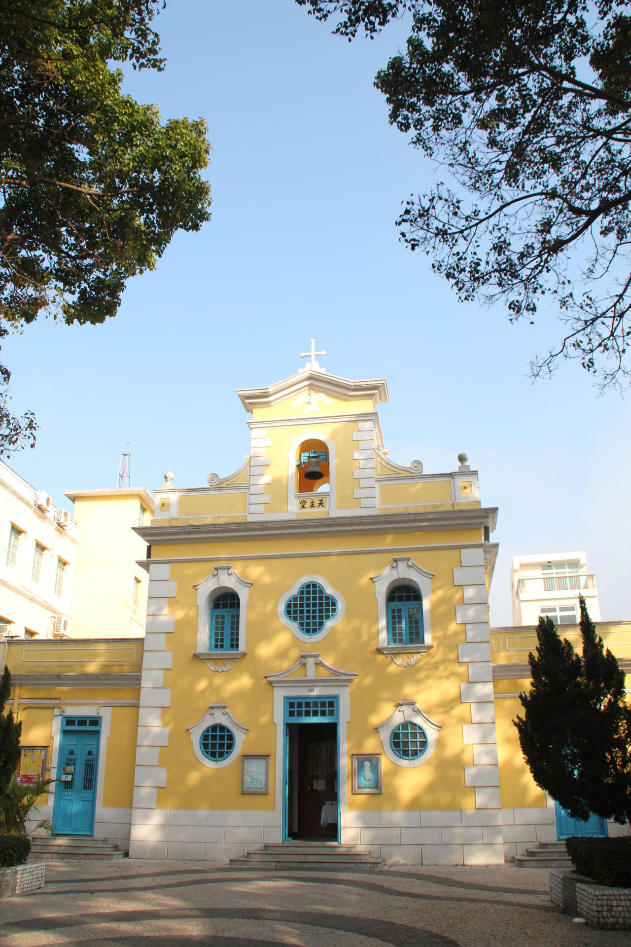 Architecture Blue Building Exterior Church City Clear Sky Colorful Building Day Historical Building Macau No People Outdoors Place Of Worship Sky Tree