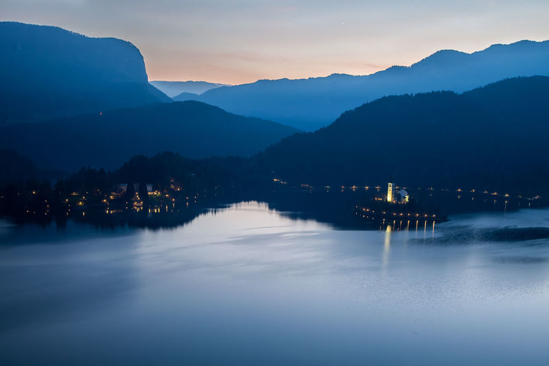 Bled's church from above Aerial View Architecture Beauty In Nature Bled, Slovenia Building Exterior Built Structure Illuminated Lake View Landscape Mountain Mountain Range Mountains Nature Night No People Outdoors Reflection River Scenics Sky Sunset Tranquil Scene Tranquility Water Waterfront