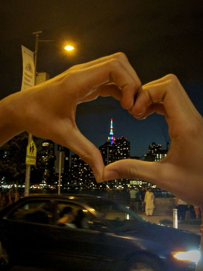 Misaligned Heart in a Fast Paced World Human Hand People Men Illuminated Night Water Only Men Outdoors Close-up Sky Human Body Part Heart Shape Heart NYC Skyline Empire State Building NYC NYC Photography Pride2017 Pride Pride Color Colorful EyeEmNewHere
