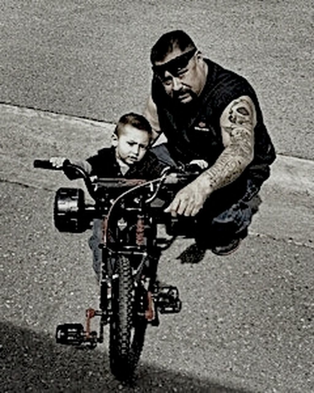 lifestyles, bicycle, transportation, full length, land vehicle, leisure activity, riding, casual clothing, mode of transport, person, street, road, young adult, shadow, cycling, motorcycle, front view, holding