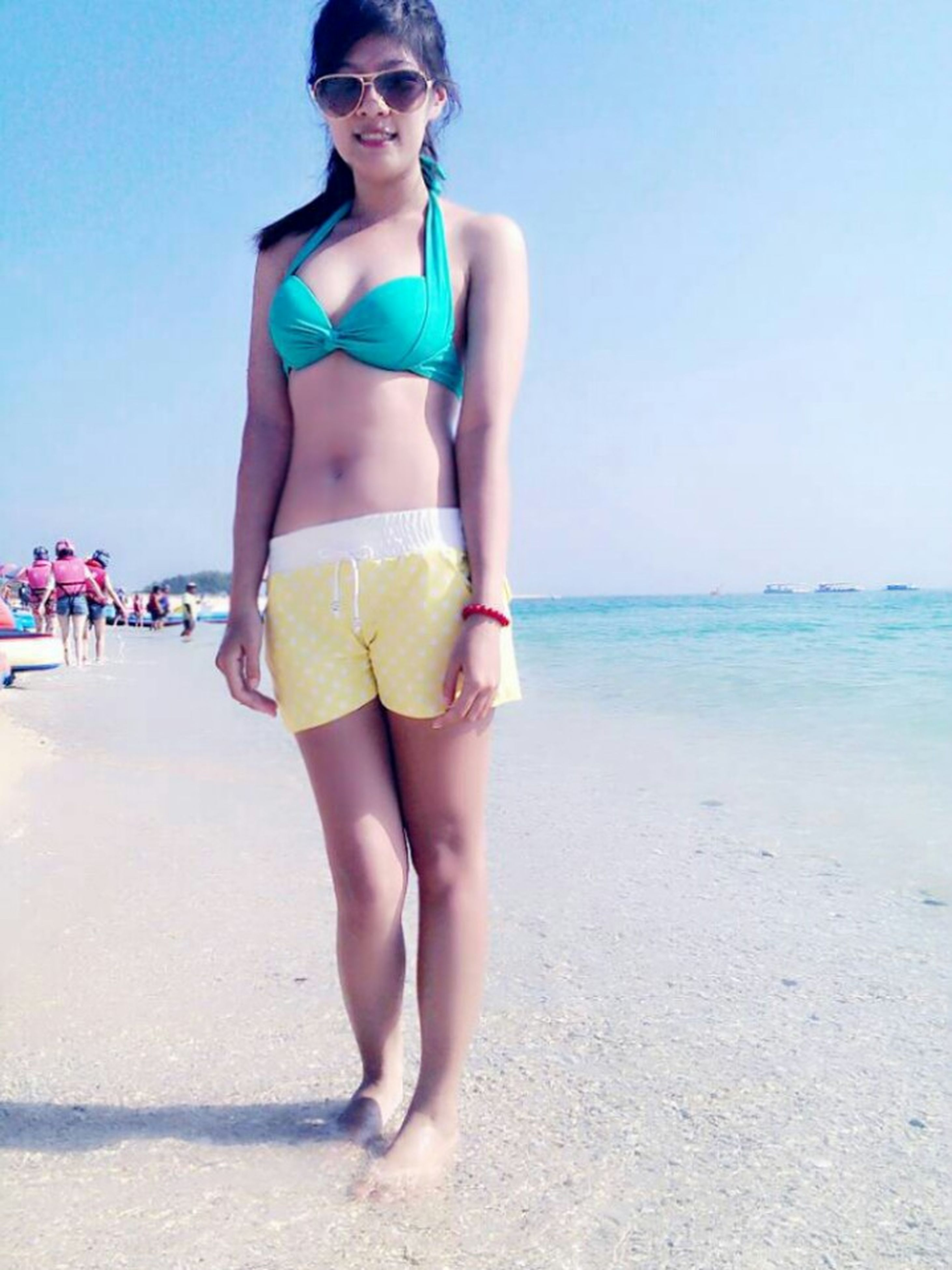 beach, young adult, sea, lifestyles, person, young women, leisure activity, sand, horizon over water, shore, water, front view, casual clothing, full length, vacations, portrait, standing