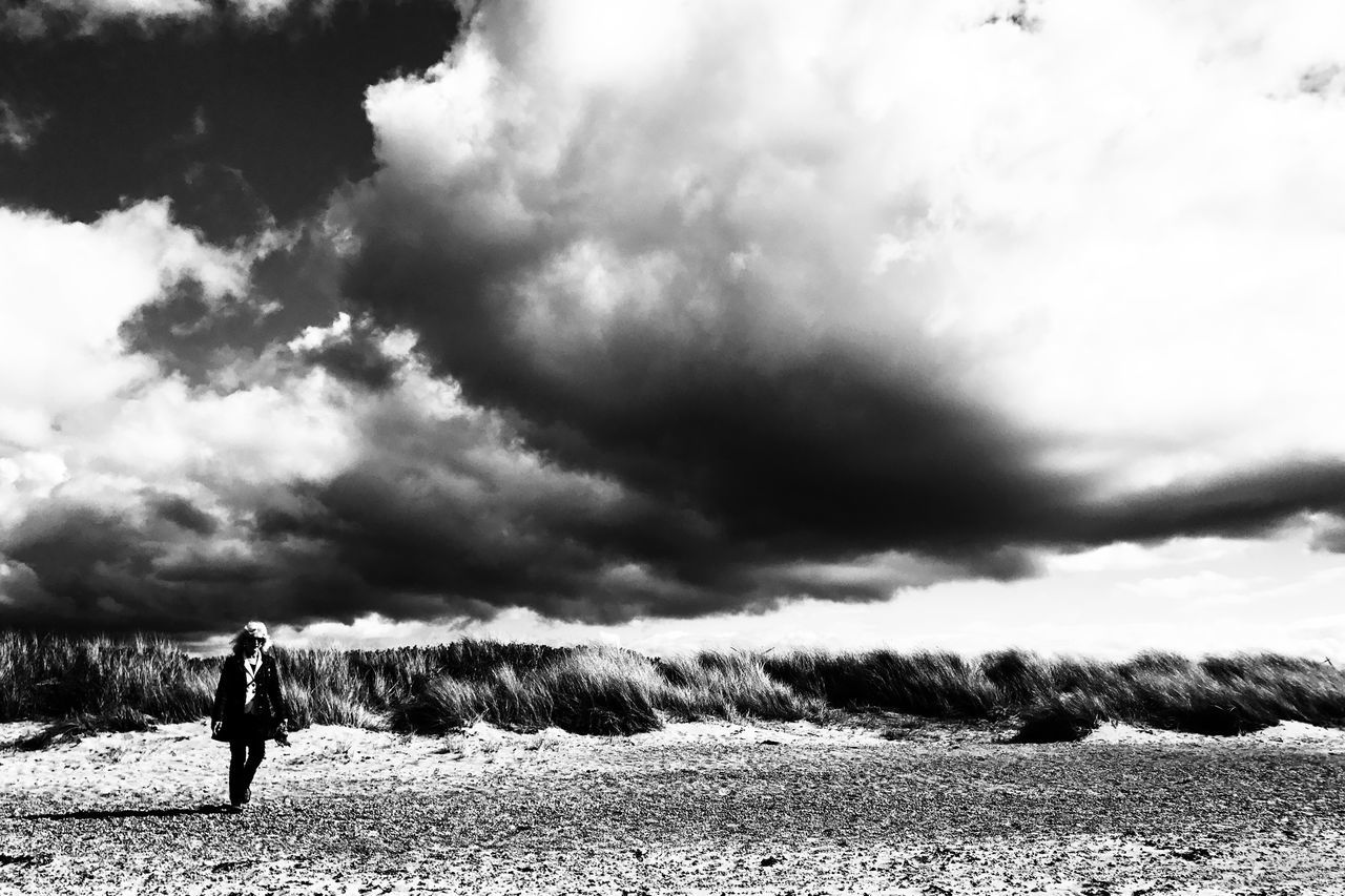Adult Adventure Beach Beauty In Nature Black & White Black And White Blackandwhite Cloud - Sky Day Field Full Length Grass Hiking Landscape Leisure Activity Lifestyles Nature One Person Outdoors Scenics Sky Sky And Clouds Vacations Walking Women