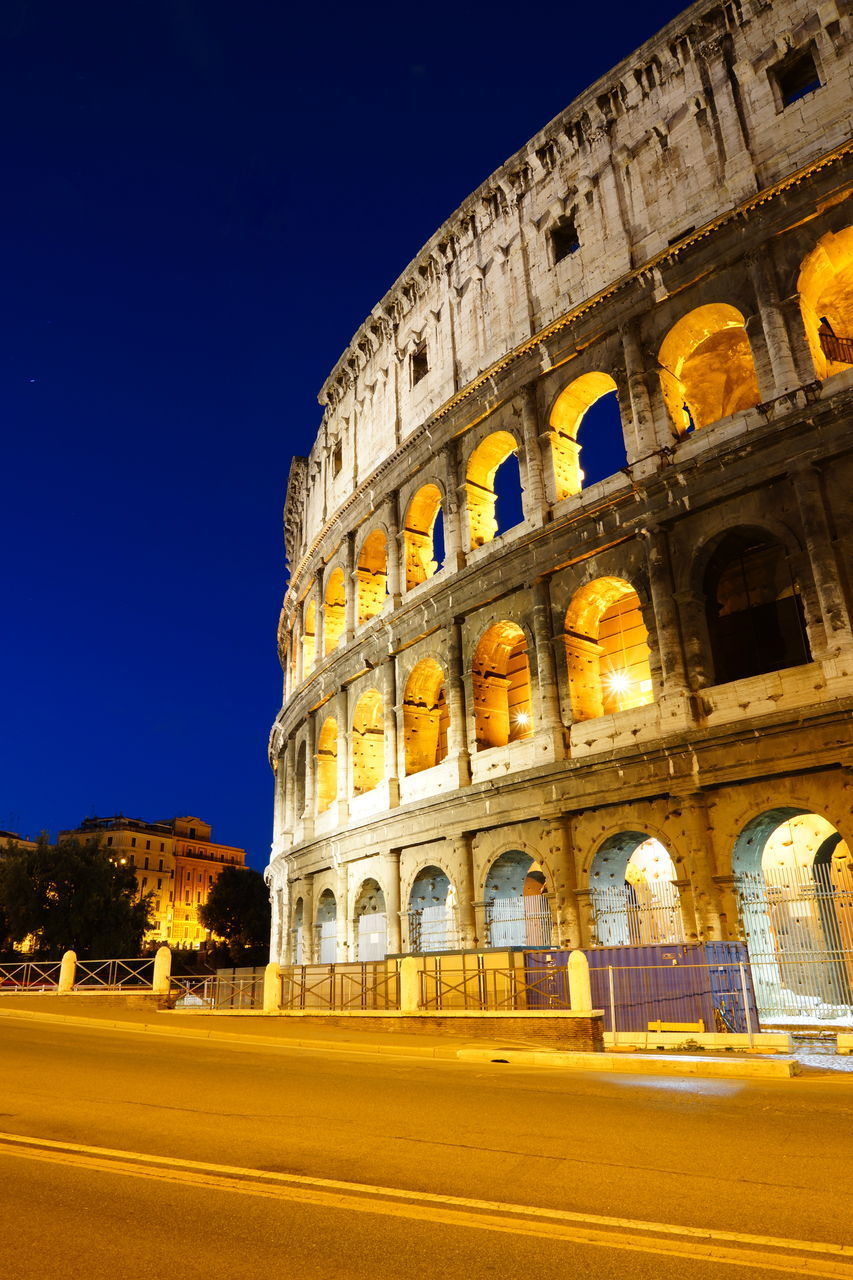 architecture, history, built structure, travel, the past, ancient, tourism, old ruin, travel destinations, arch, building exterior, clear sky, outdoors, night, ancient civilization, arts culture and entertainment, illuminated, sky, city, no people