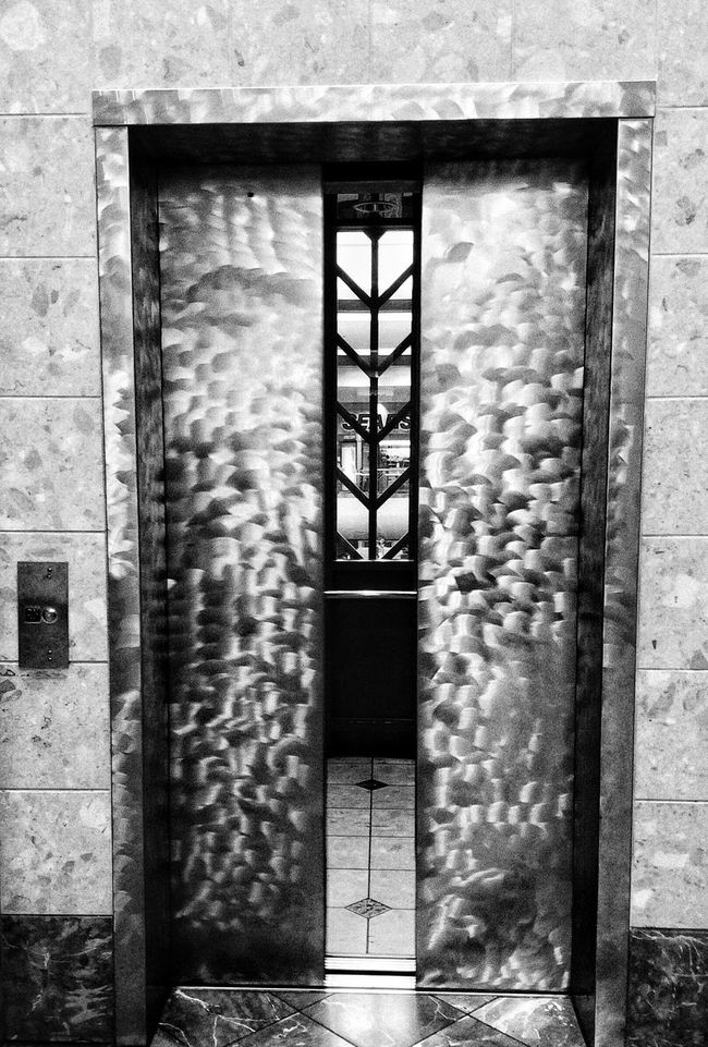 Monochrome Architecture Built Structure Entrance Building Exterior Entryway No People Day Outdoors Ajar Elevator Elevator Door Elevator Button Shopping Mall Metrocenter Phoenix Arizona Blackandwhite Eye For Photography Atmosphere Adventure The Way Forward Darkness And Light Illuminated Modern