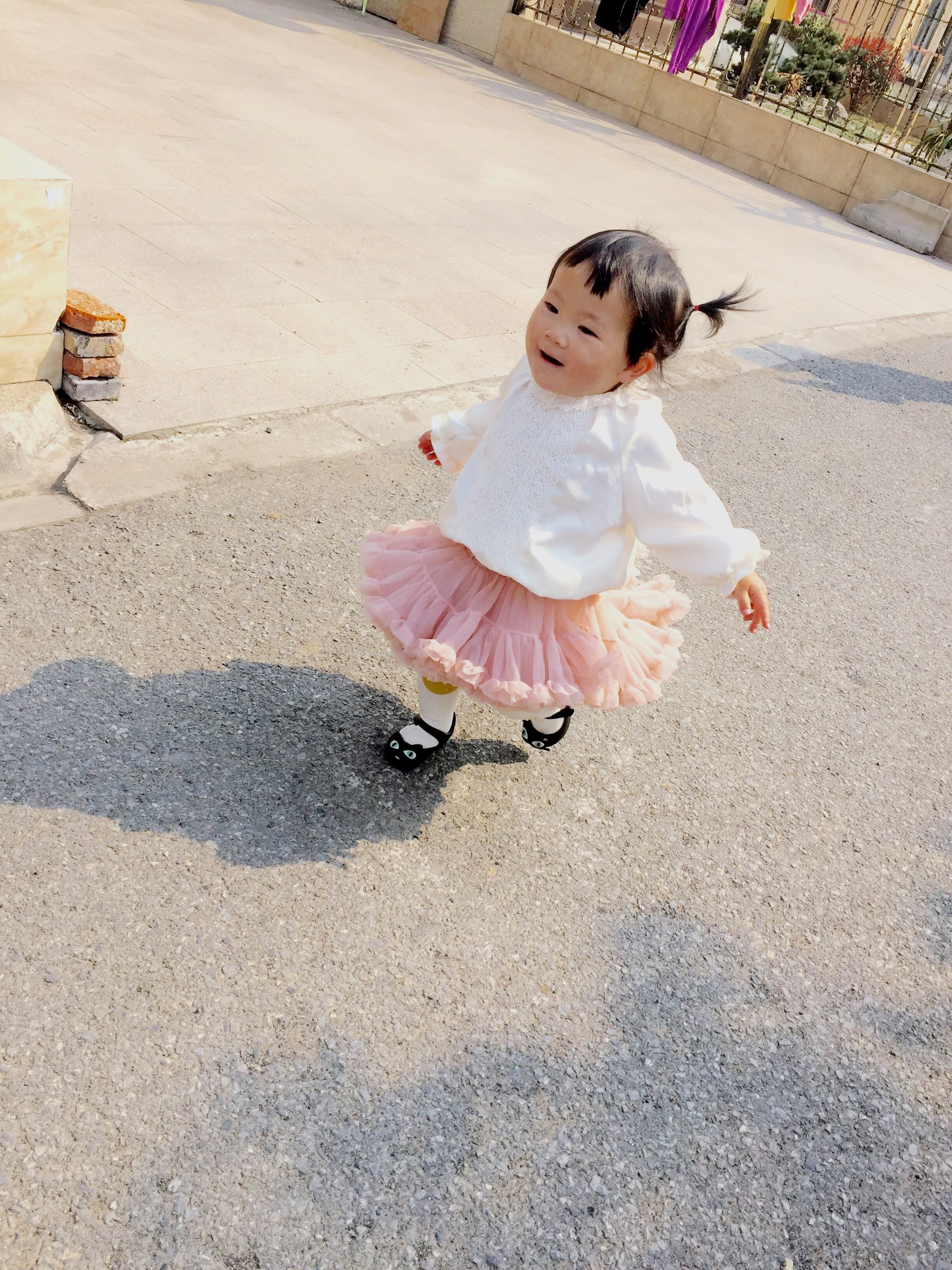 childhood, full length, elementary age, person, innocence, high angle view, girls, cute, lifestyles, leisure activity, toy, boys, street, casual clothing, playful, happiness, fun, playing