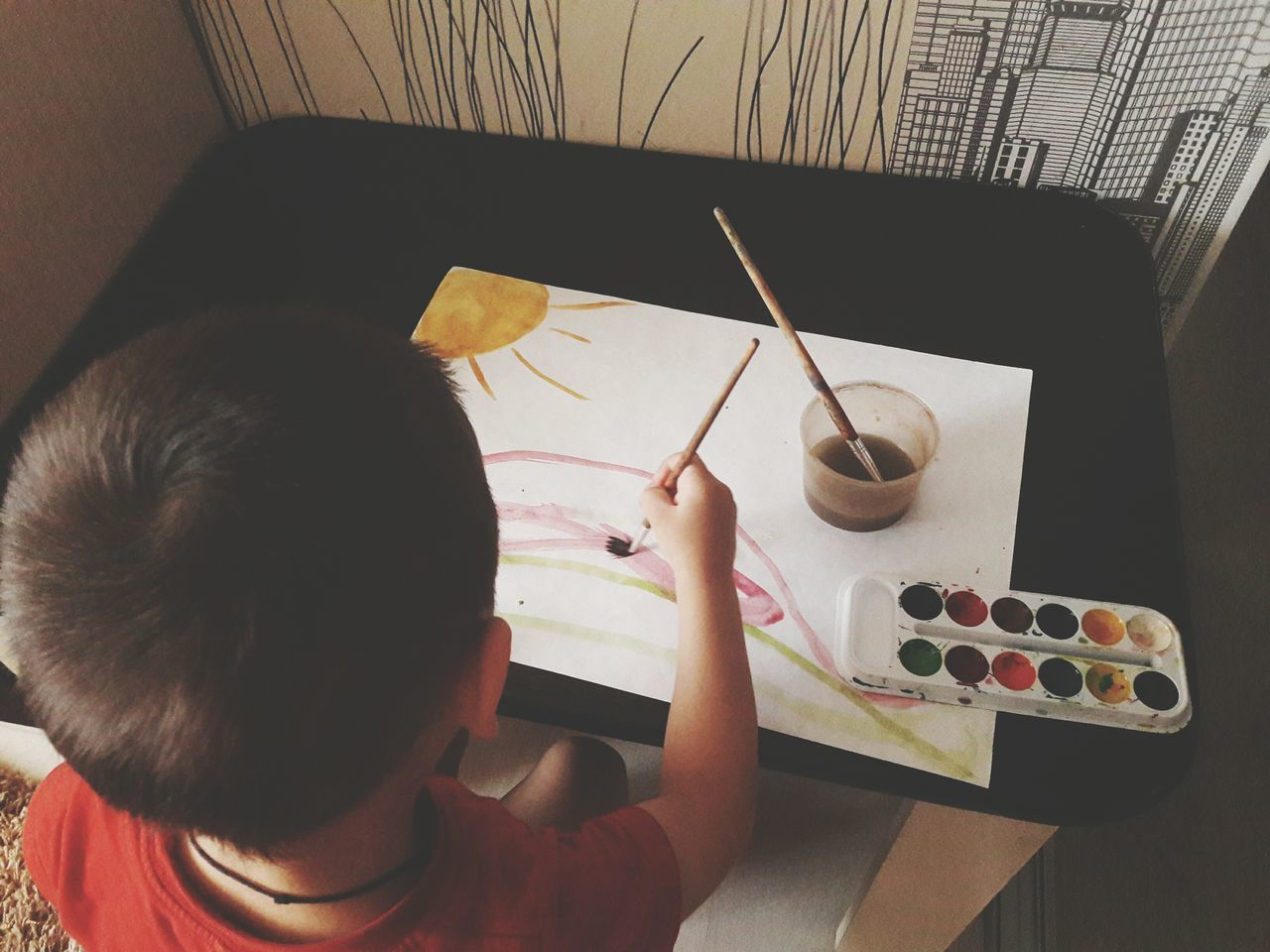 indoors, high angle view, real people, table, boys, one person, childhood, leisure activity, learning, home interior, playing, sitting, lifestyles, child, day, one boy only, people