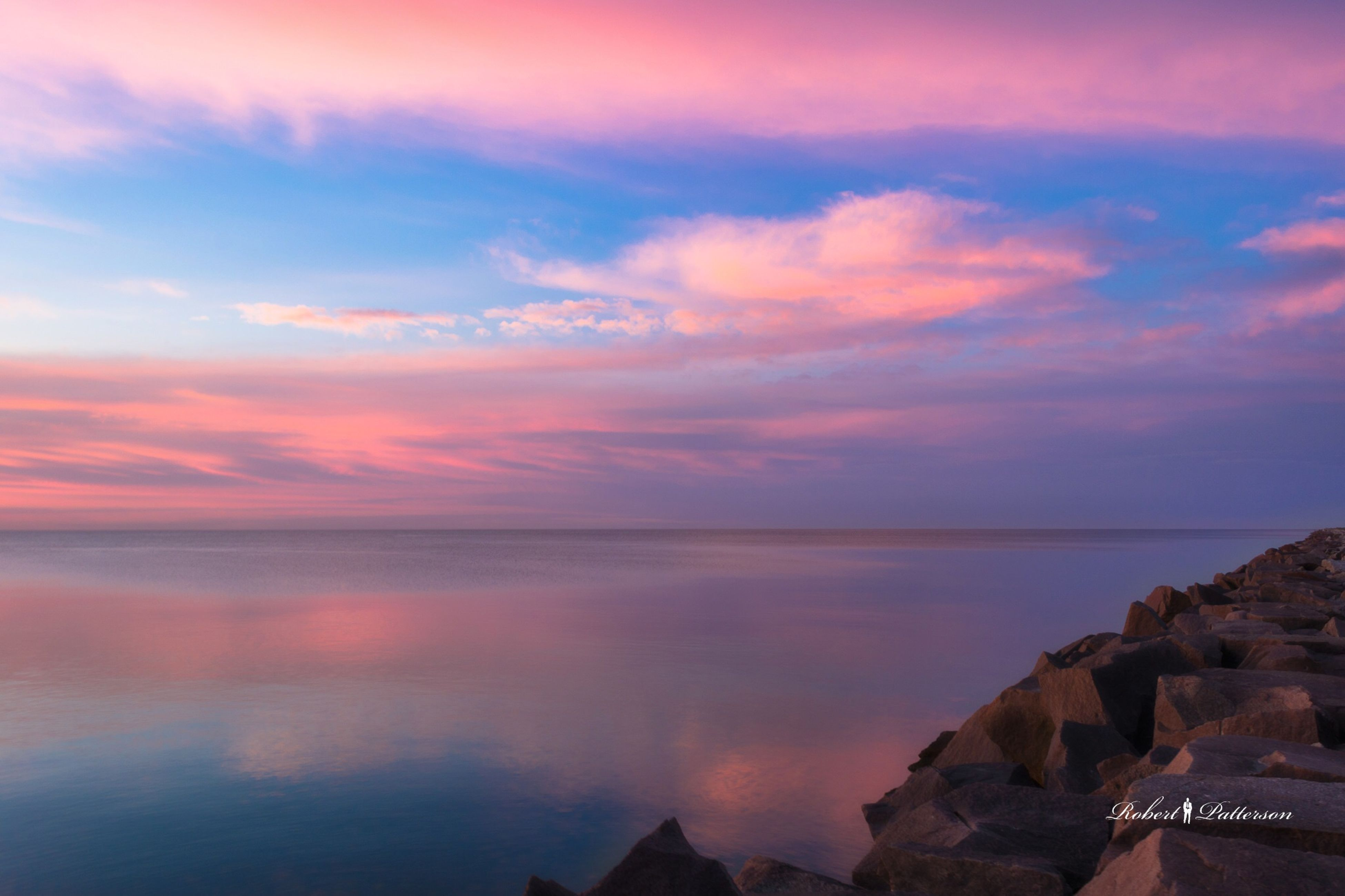 tranquil scene, water, sea, scenics, tranquility, sunset, beauty in nature, horizon over water, cloud - sky, rock - object, sky, tourism, vacations, idyllic, nature, atmosphere, travel destinations, non-urban scene, seascape, majestic, atmospheric mood, dramatic sky, rock formation, cloudscape, distant, coastal feature, remote, orange color, geology, cliff, no people